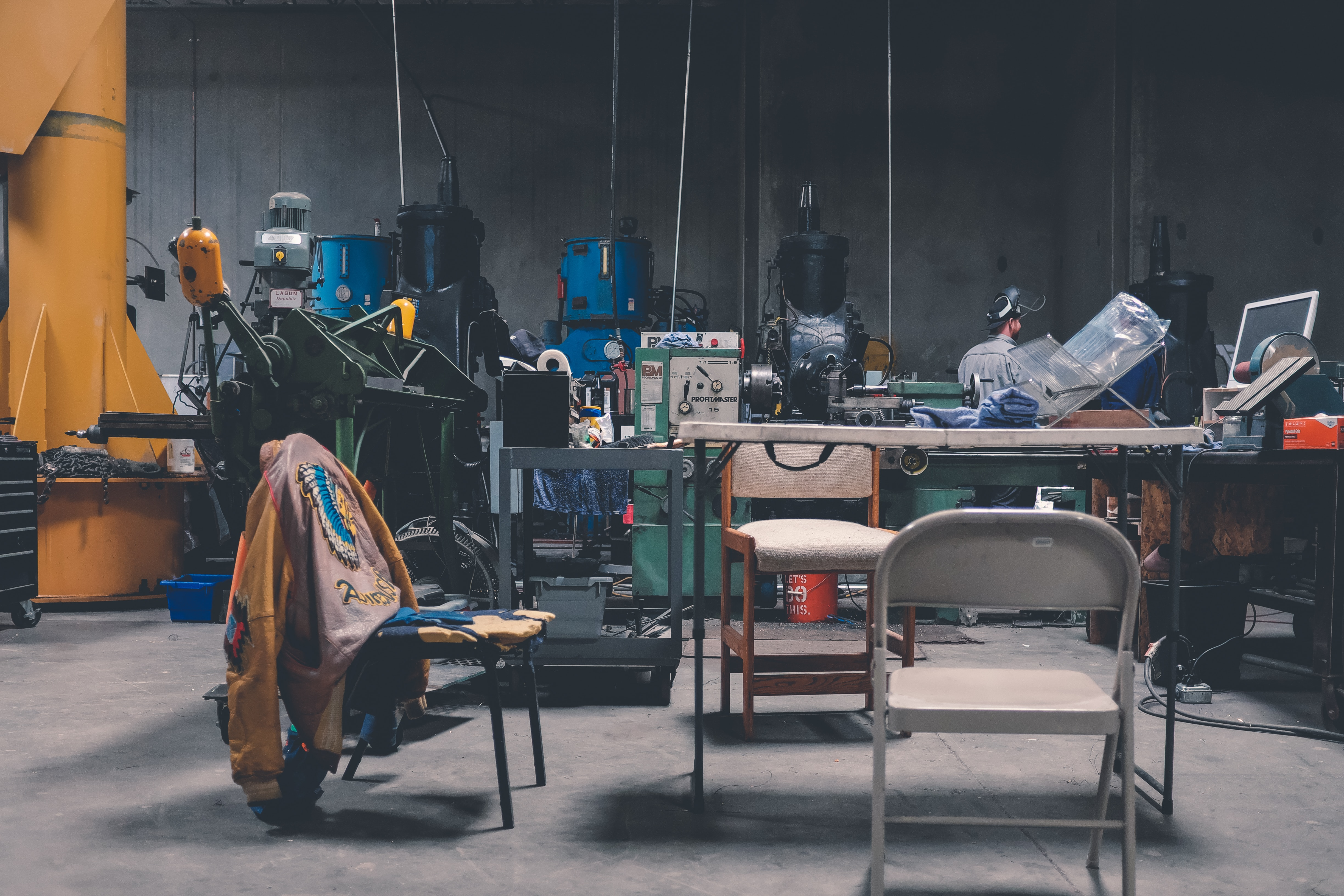photo of industrial machines near table