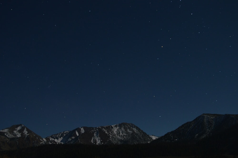 landscape photography of mountain at night