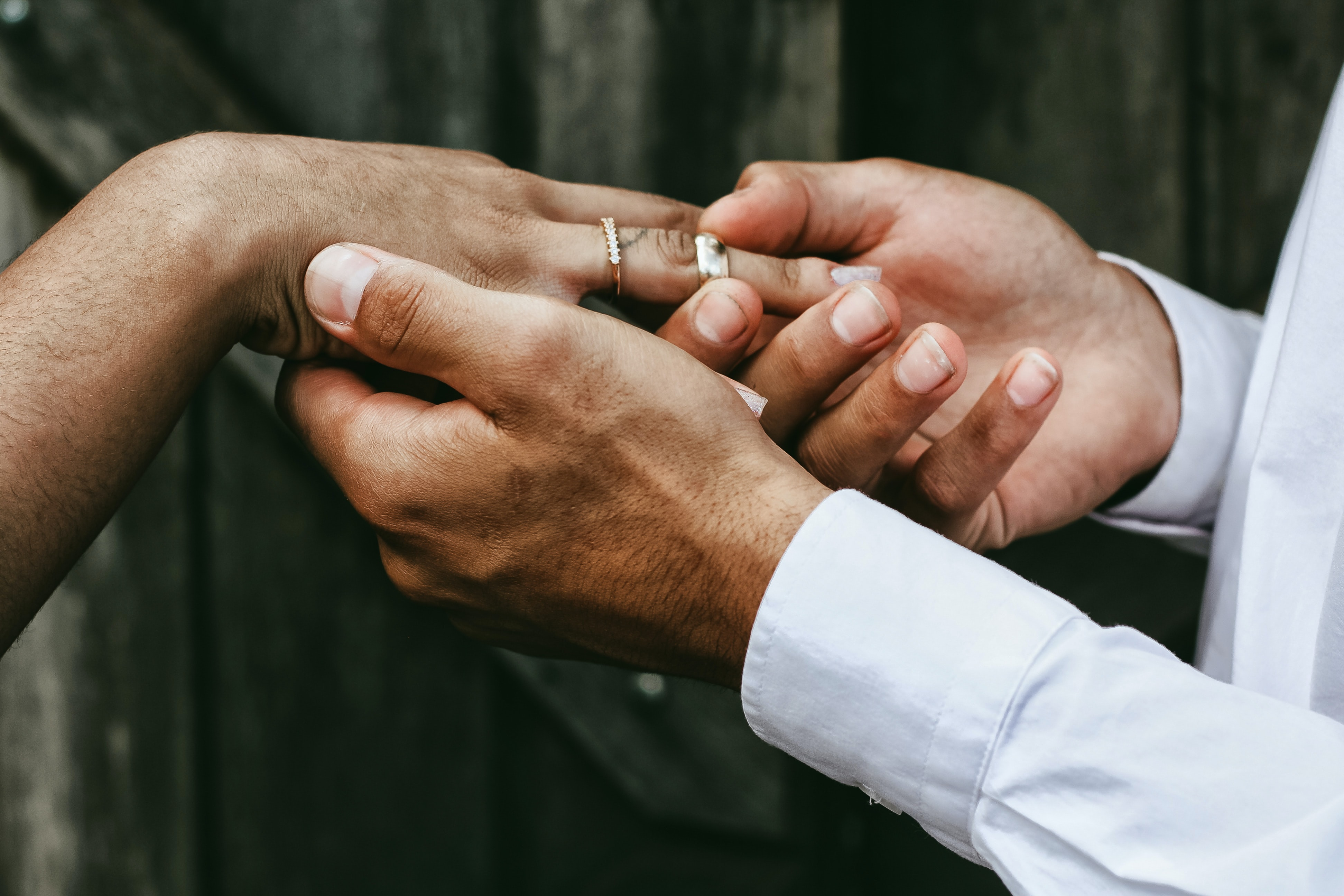 Groom Slips The Ring On The Finger Of His Bride On Their Wedding Day