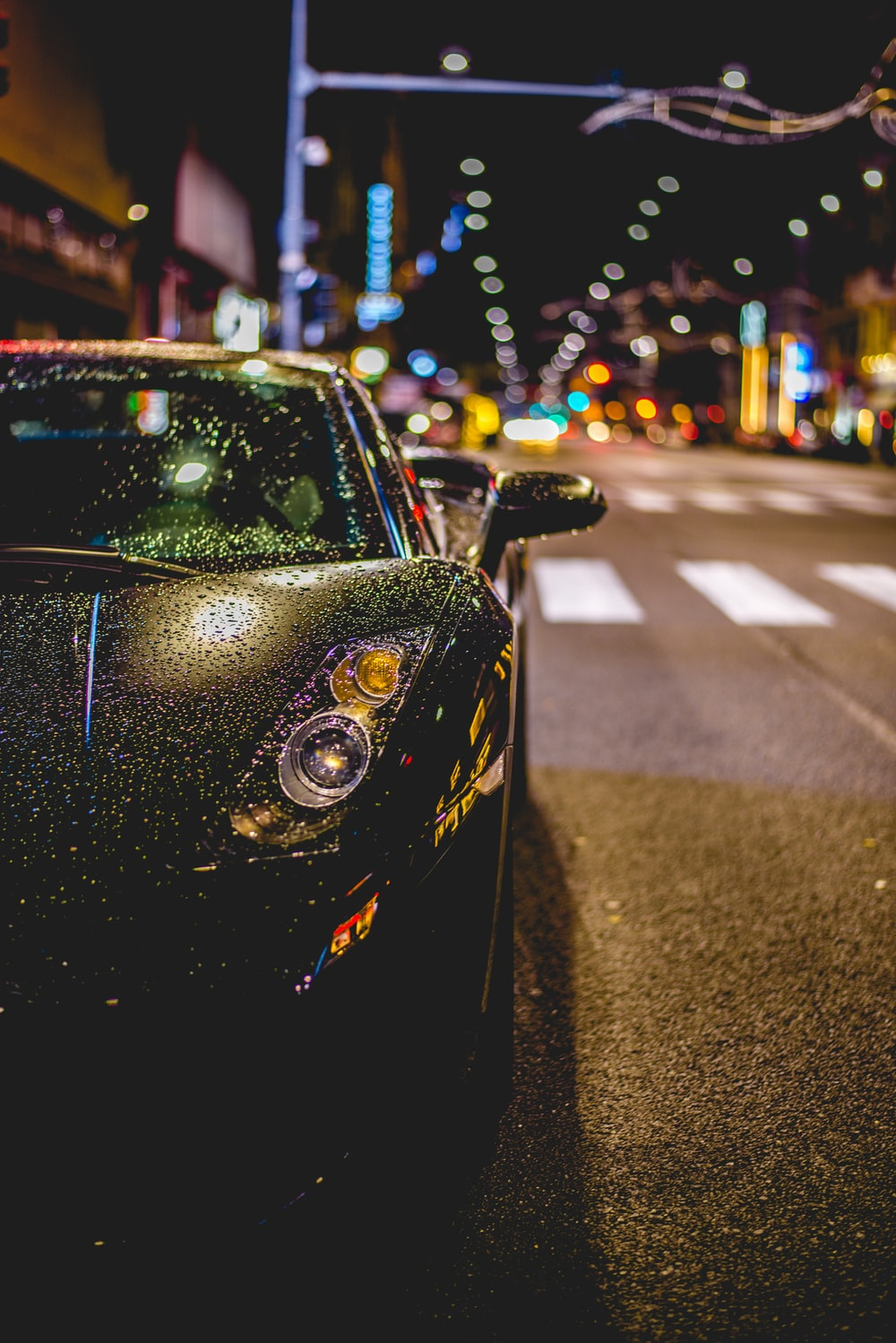 close photography of black convertible on road
