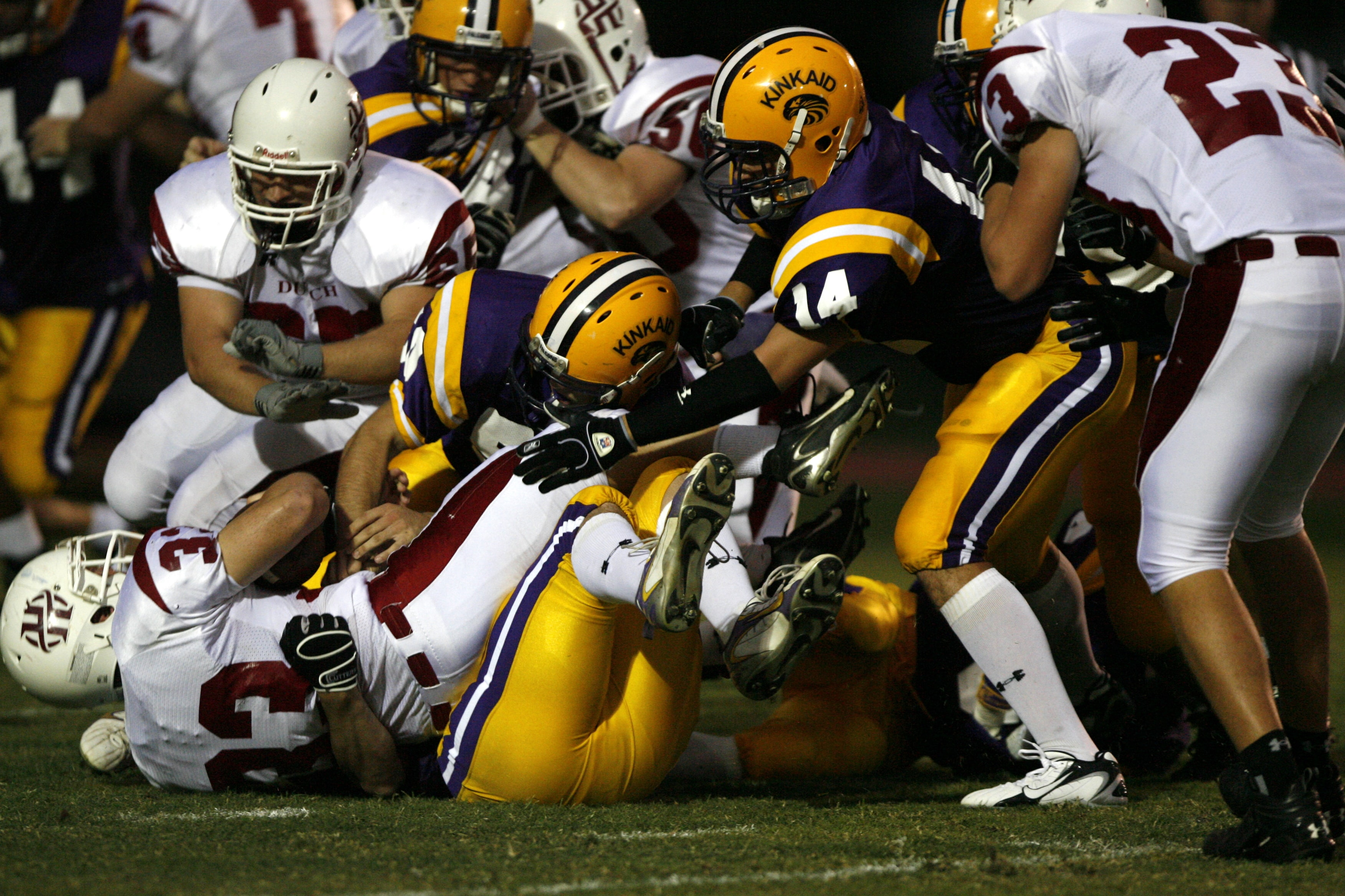 football players tumbles on each other