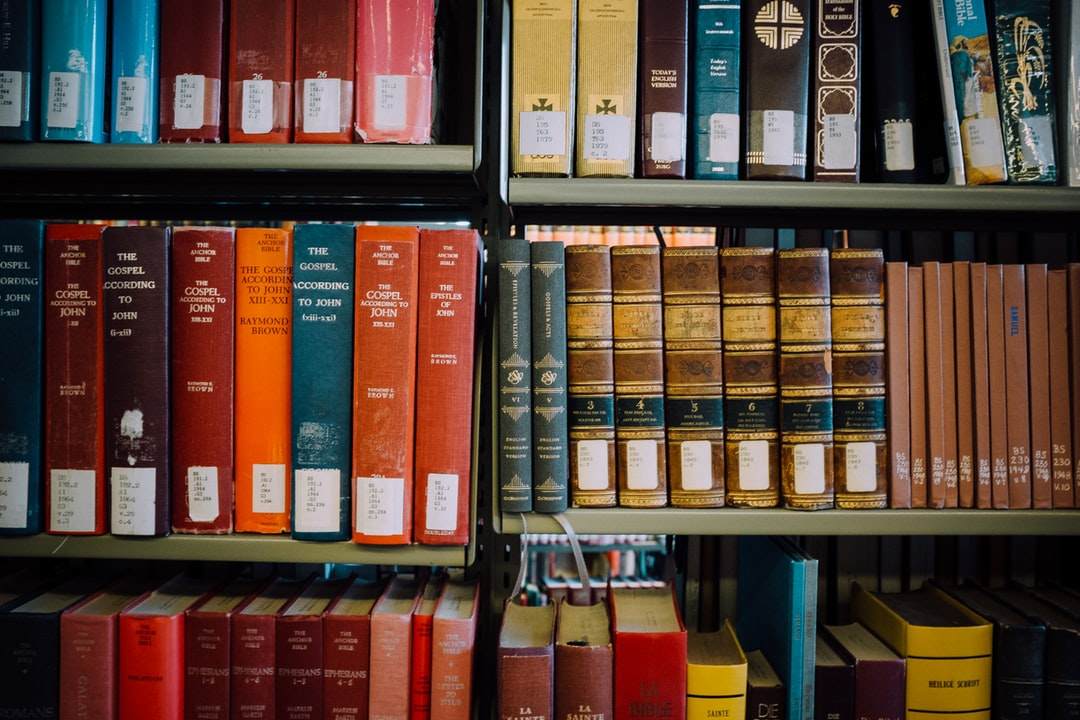 Crossway Reader's Bible and commentaries on shelves at the seminary library of Mt. Angel Abbey in Mt. Angel, OR.  https://www.crossway.org/bibles/esv-readers-bible-six-volume-set-cob/