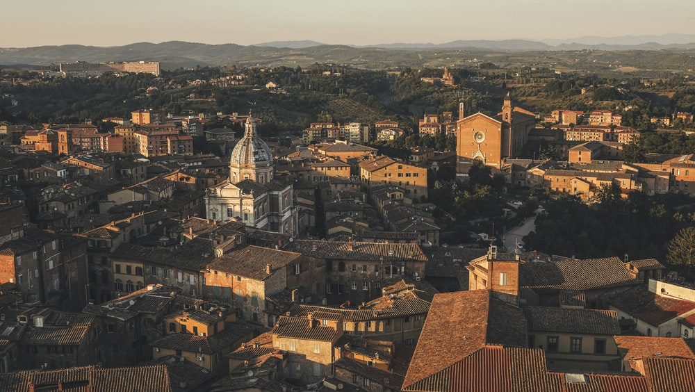 Beautiful aerial view by a drone of Siena, Italy. Charming old buildings showcase western Europe's architecture.