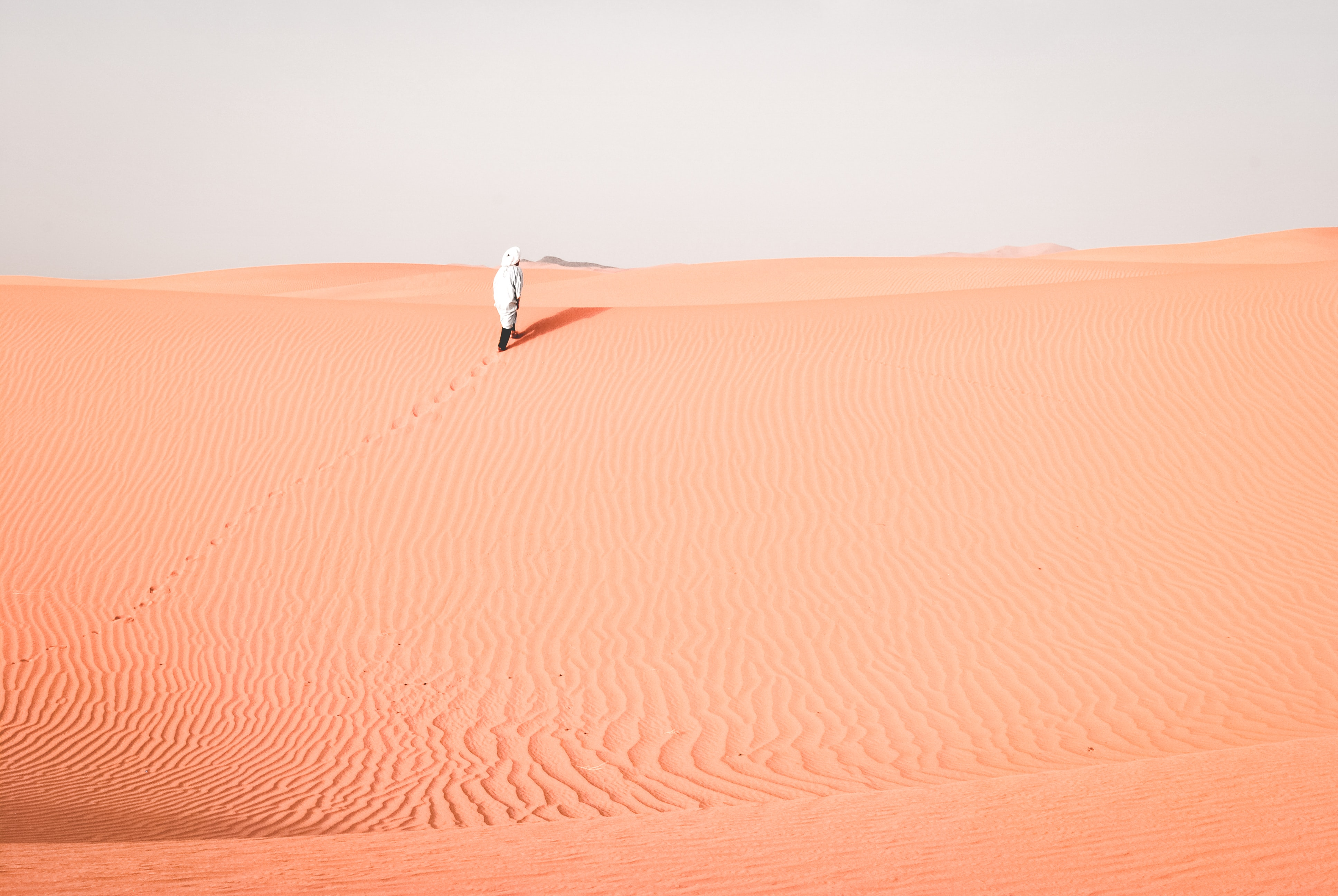 Hiking through rippled sand dunes of Erg Chebbi