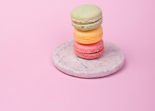 three French macaroons on plate