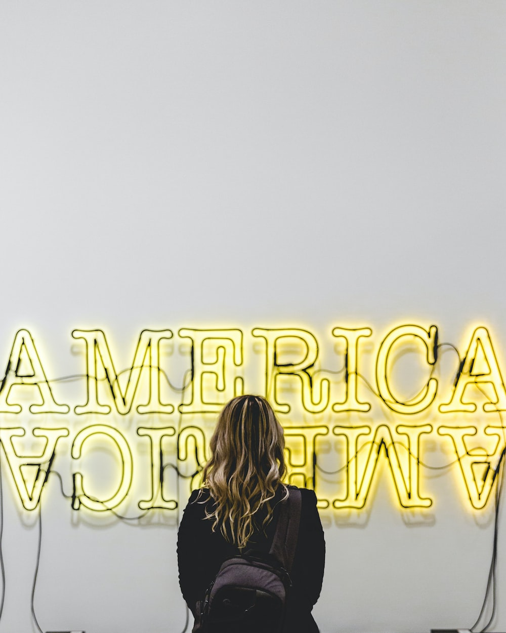 woman in front American lighted signage