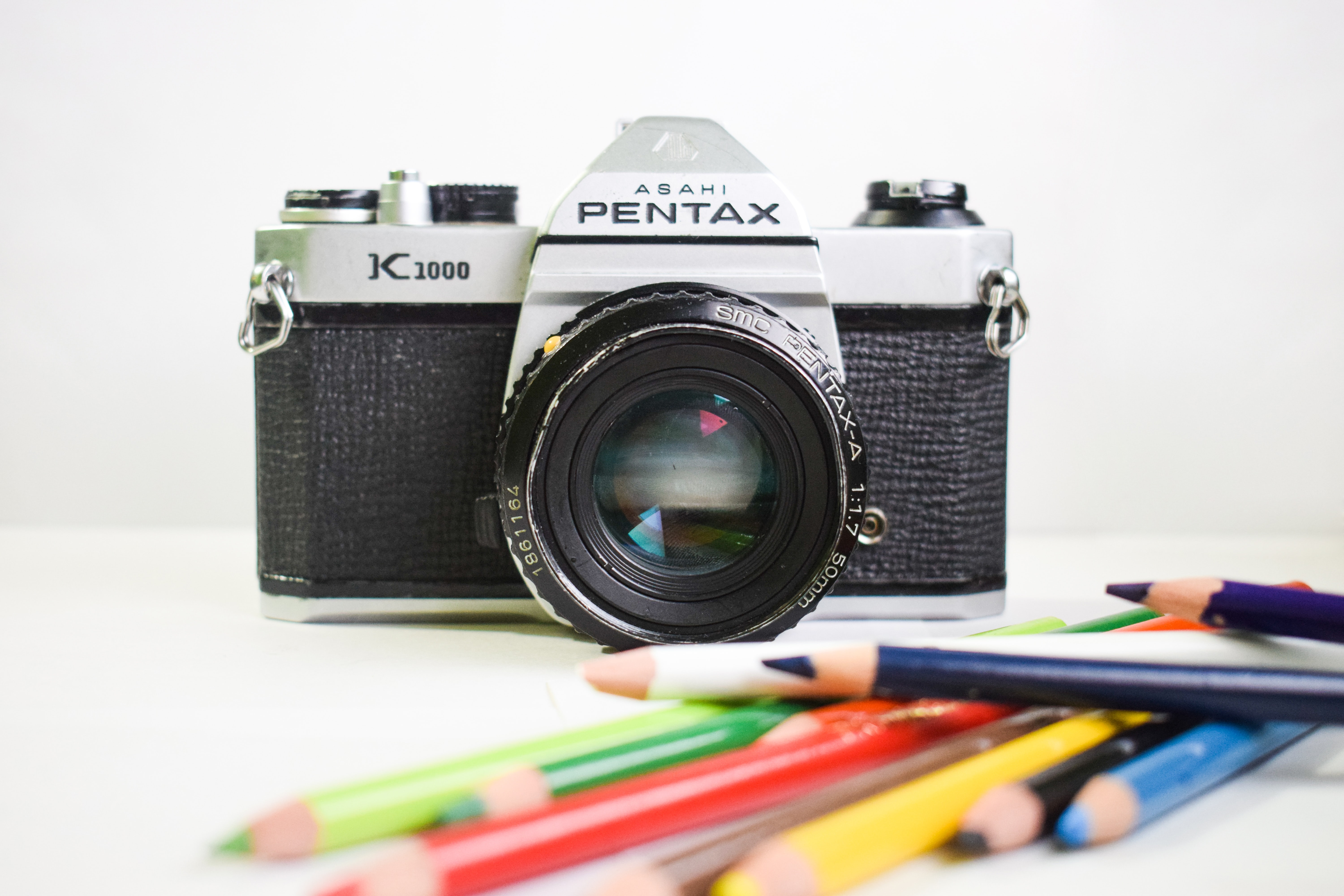selective focus photography of Pentax K1000 camera