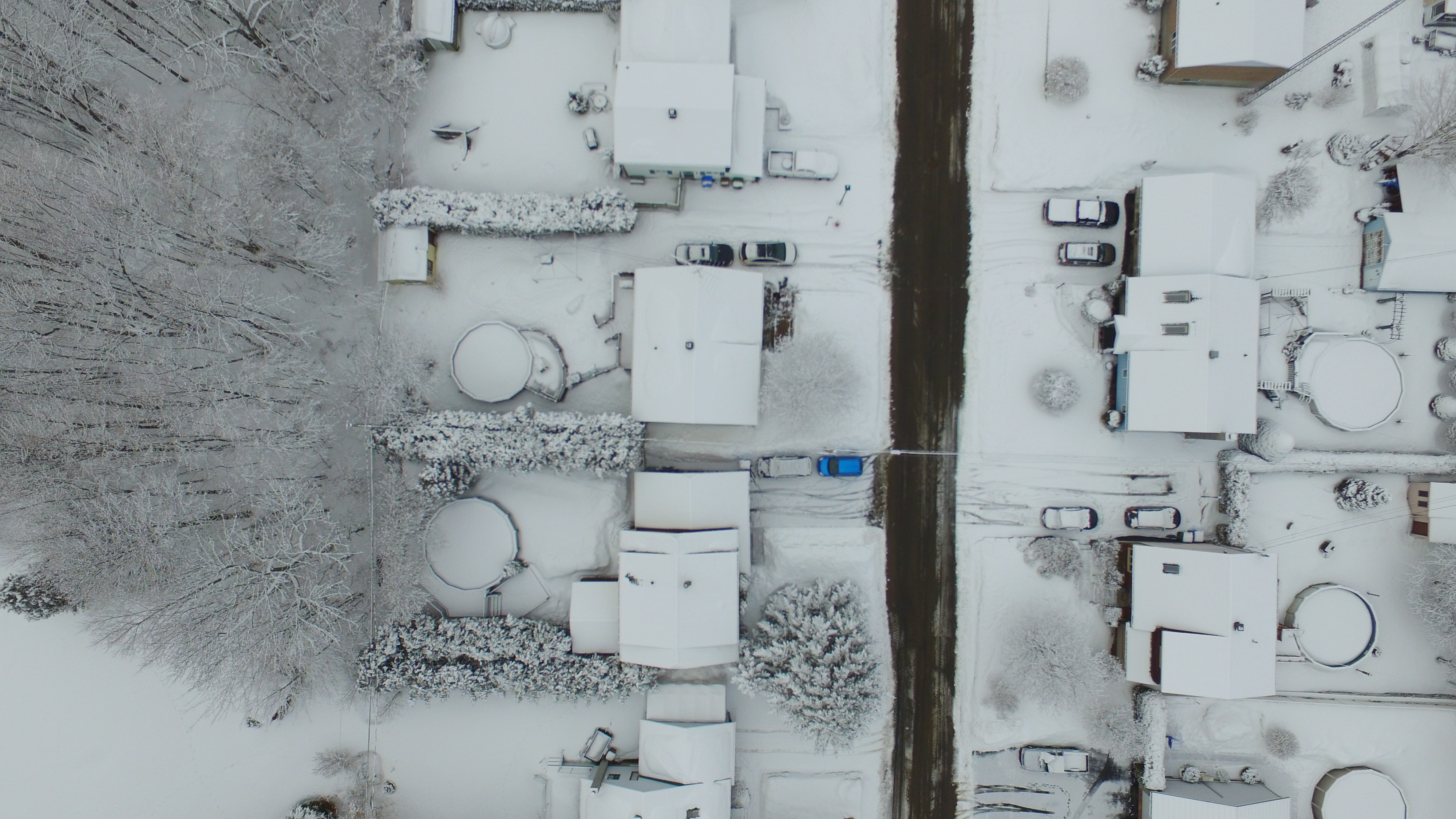 birds eye photography of snow covered residential area