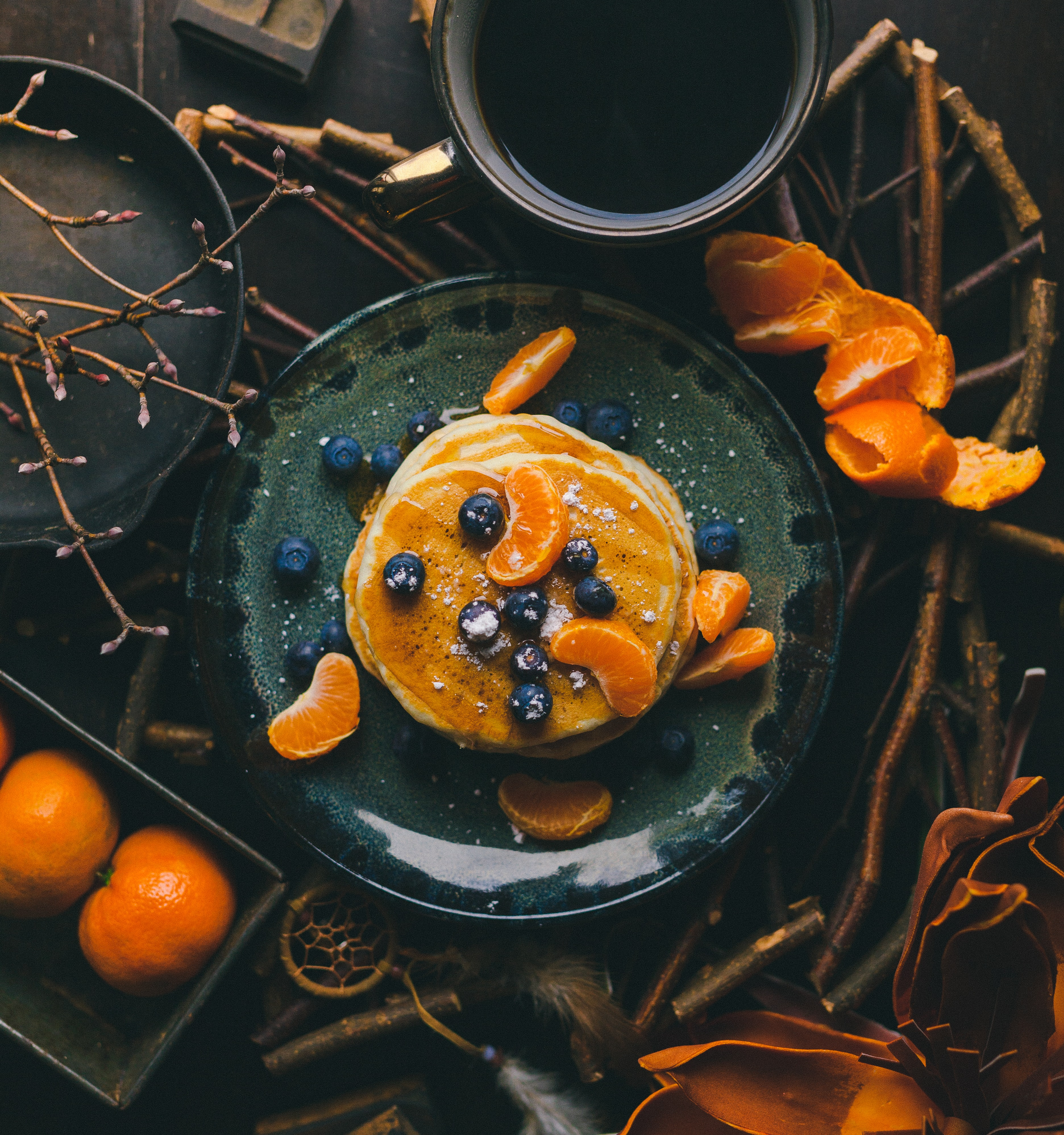 pancakes with orange and blueberry on plate