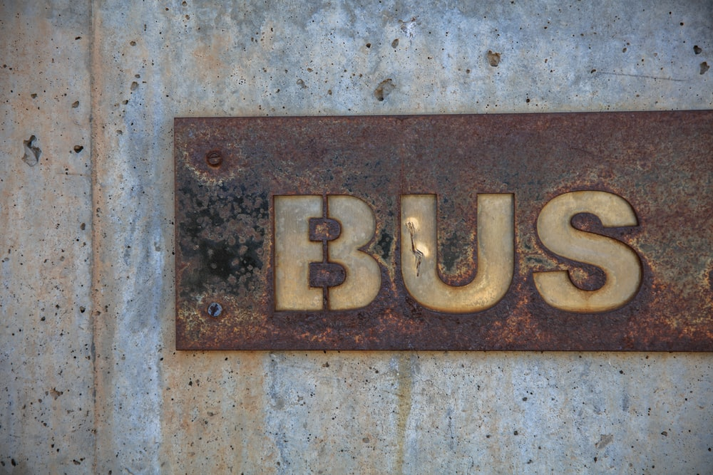 brown bus signage installed on wall