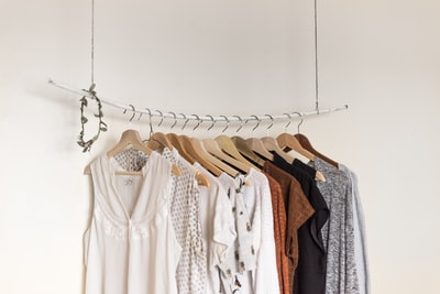 assorted clothes in wooden hangers fashion zoom background