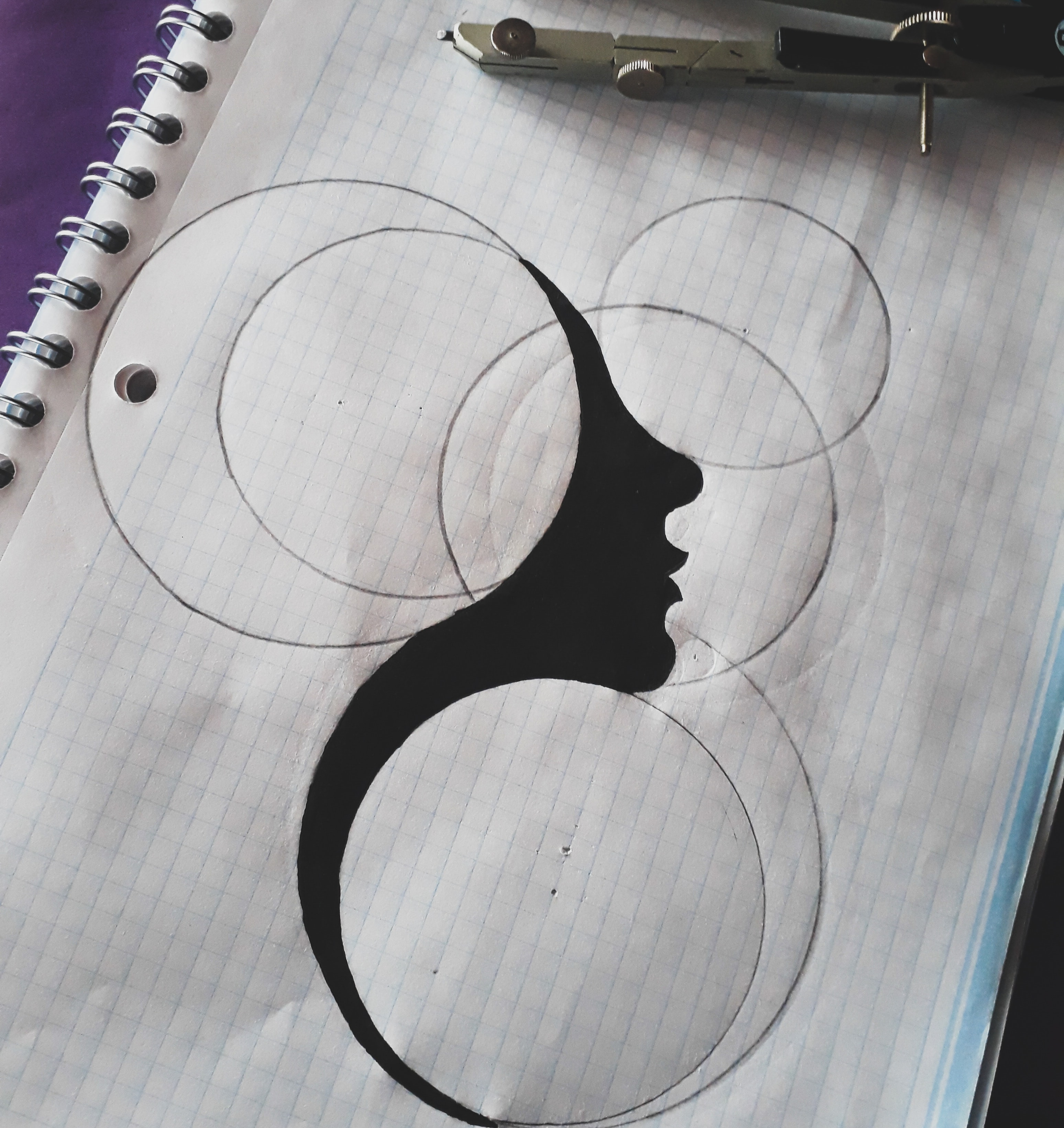 /An abstract face drawing made with a black pen.