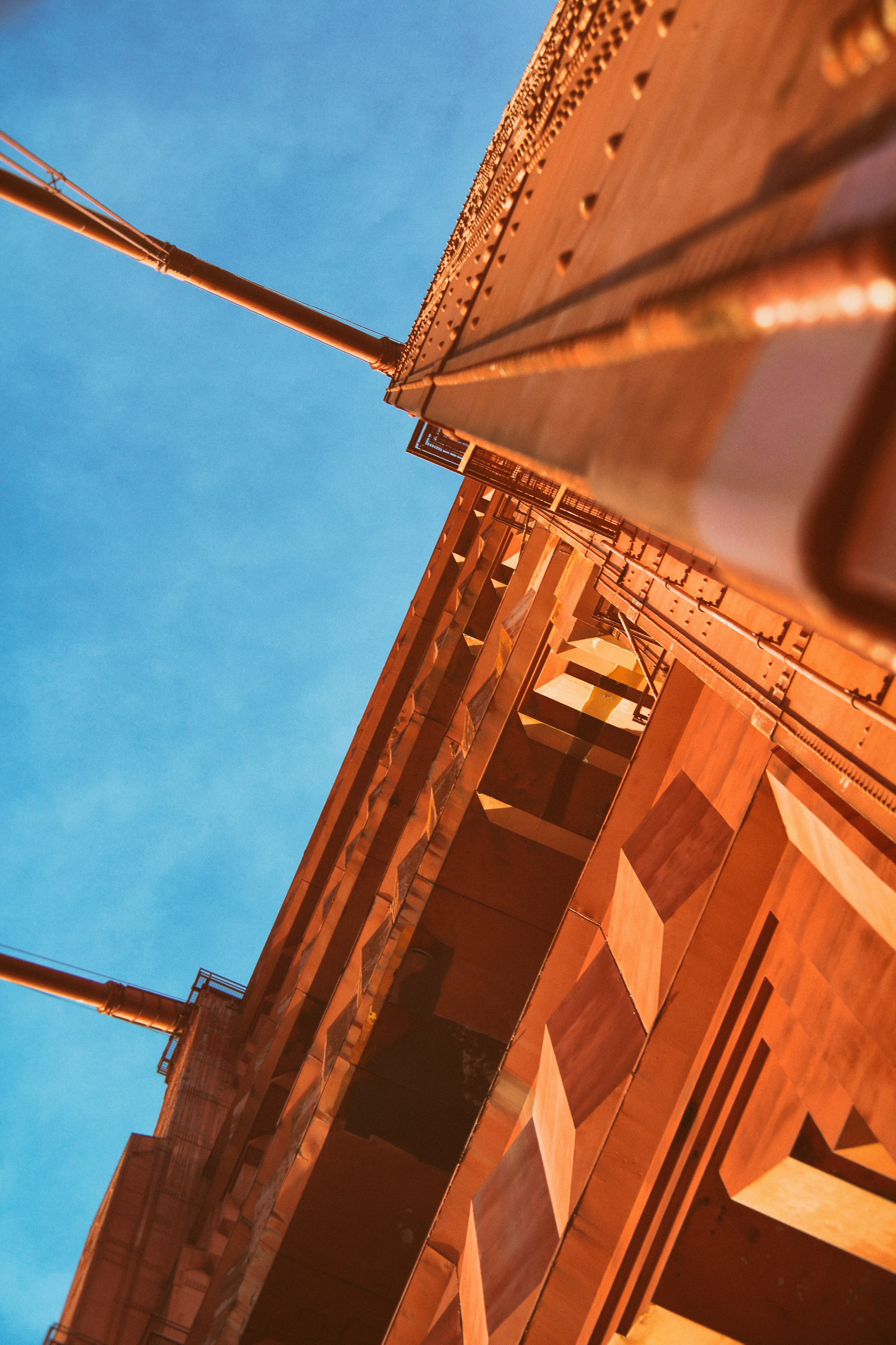 low angle photography of wooden building under blue sky