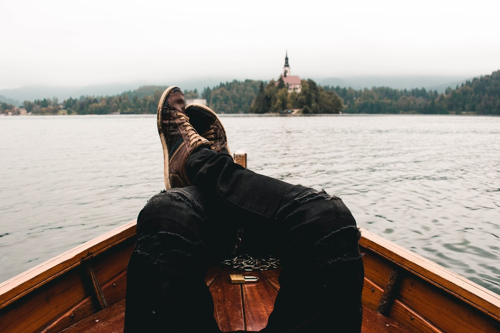 person wearing distressed black jeans on boat