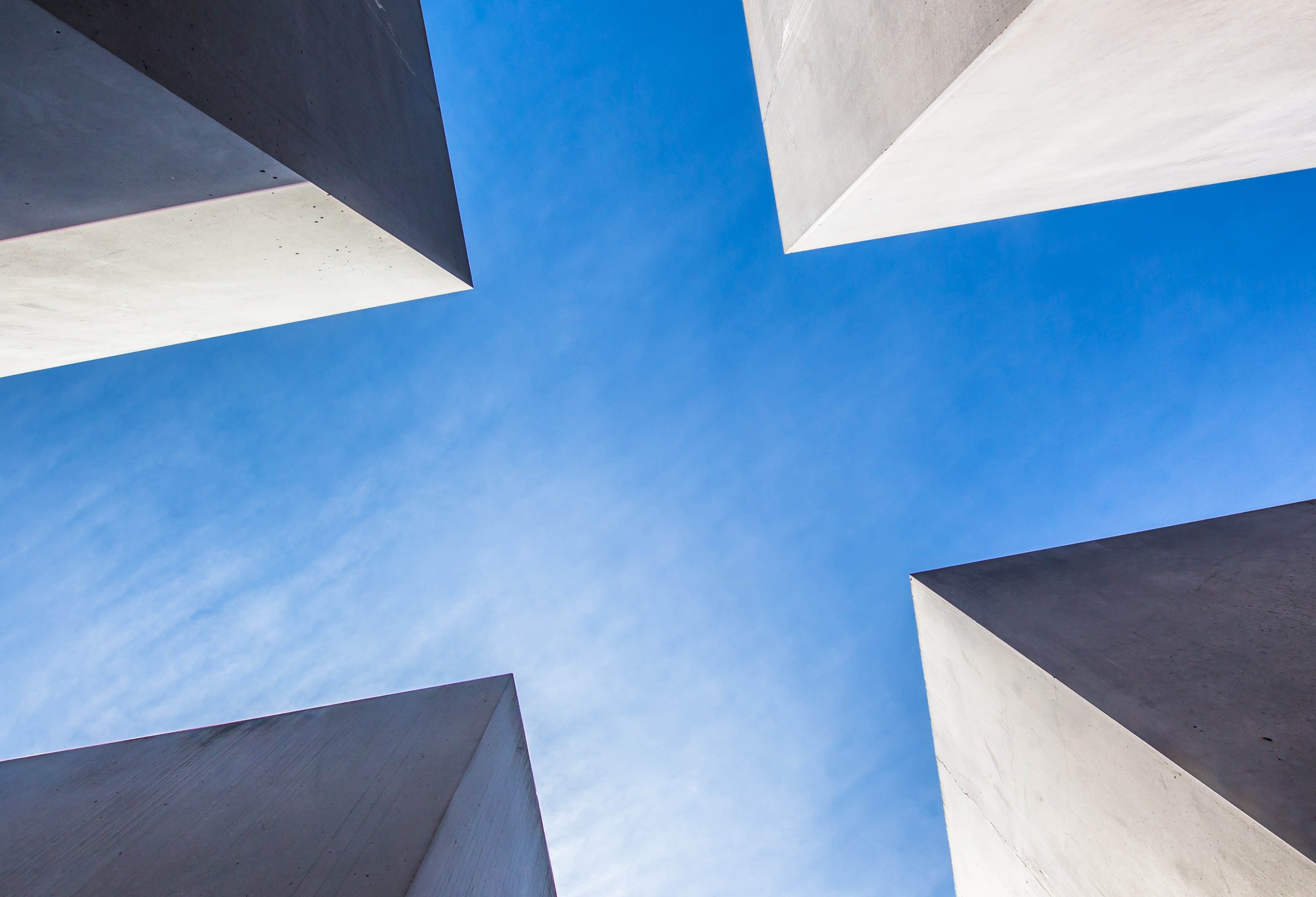 low angle photography of concrete buildings under blue sky