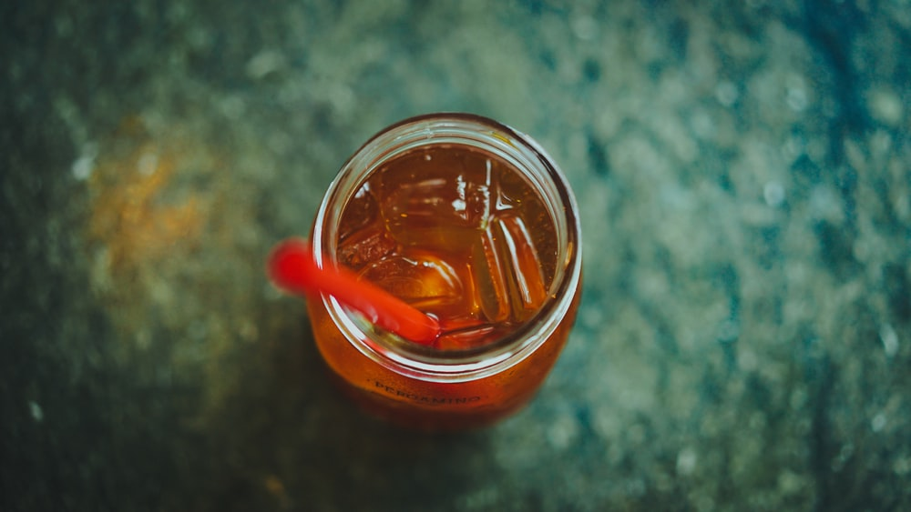 clear glass jar with red straw