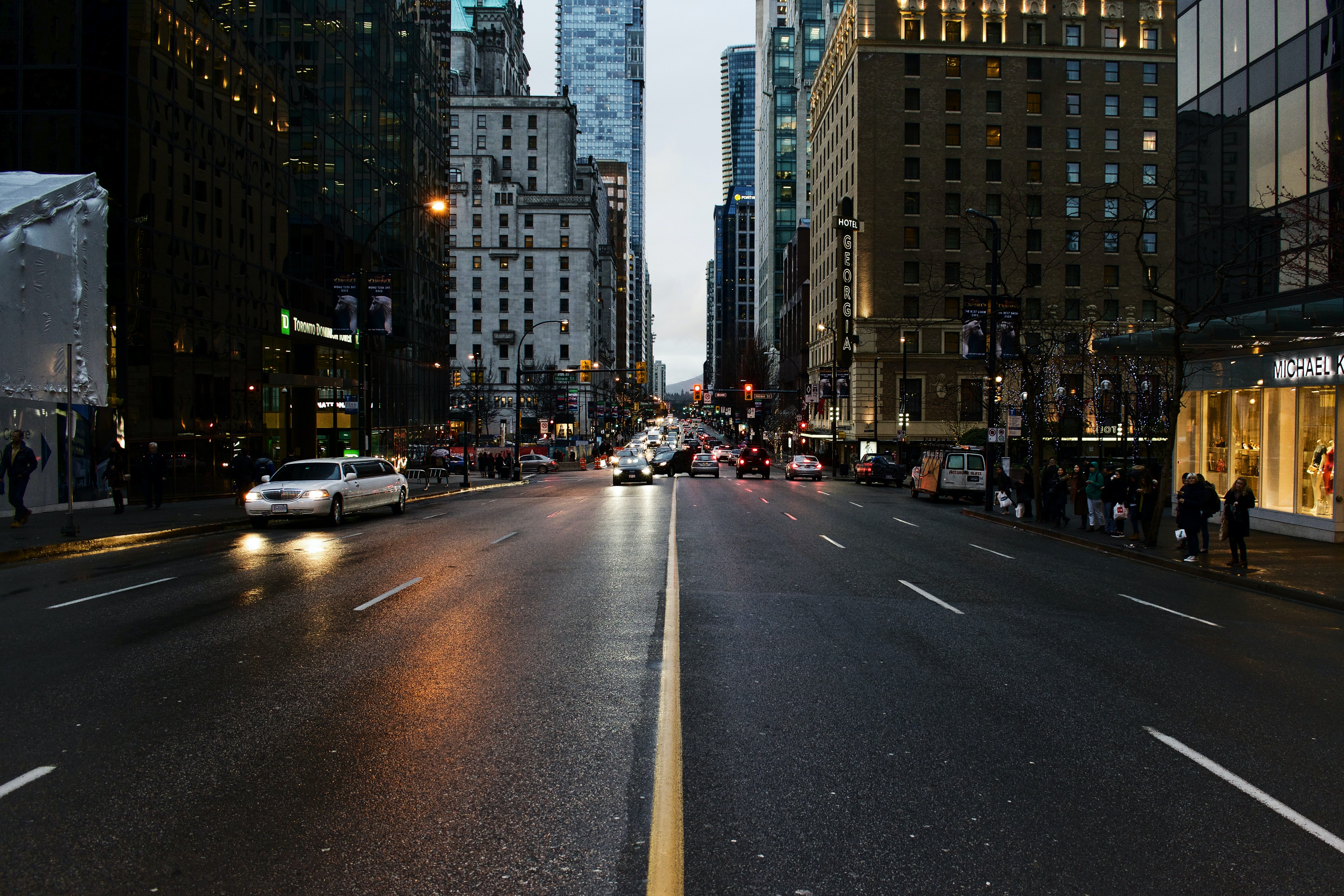 Middle of a Vancouver street, showing cars and buildings from a person's perspective