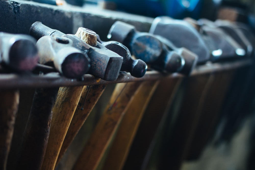 selective focus photo of black-and-brown ball-peen hammers