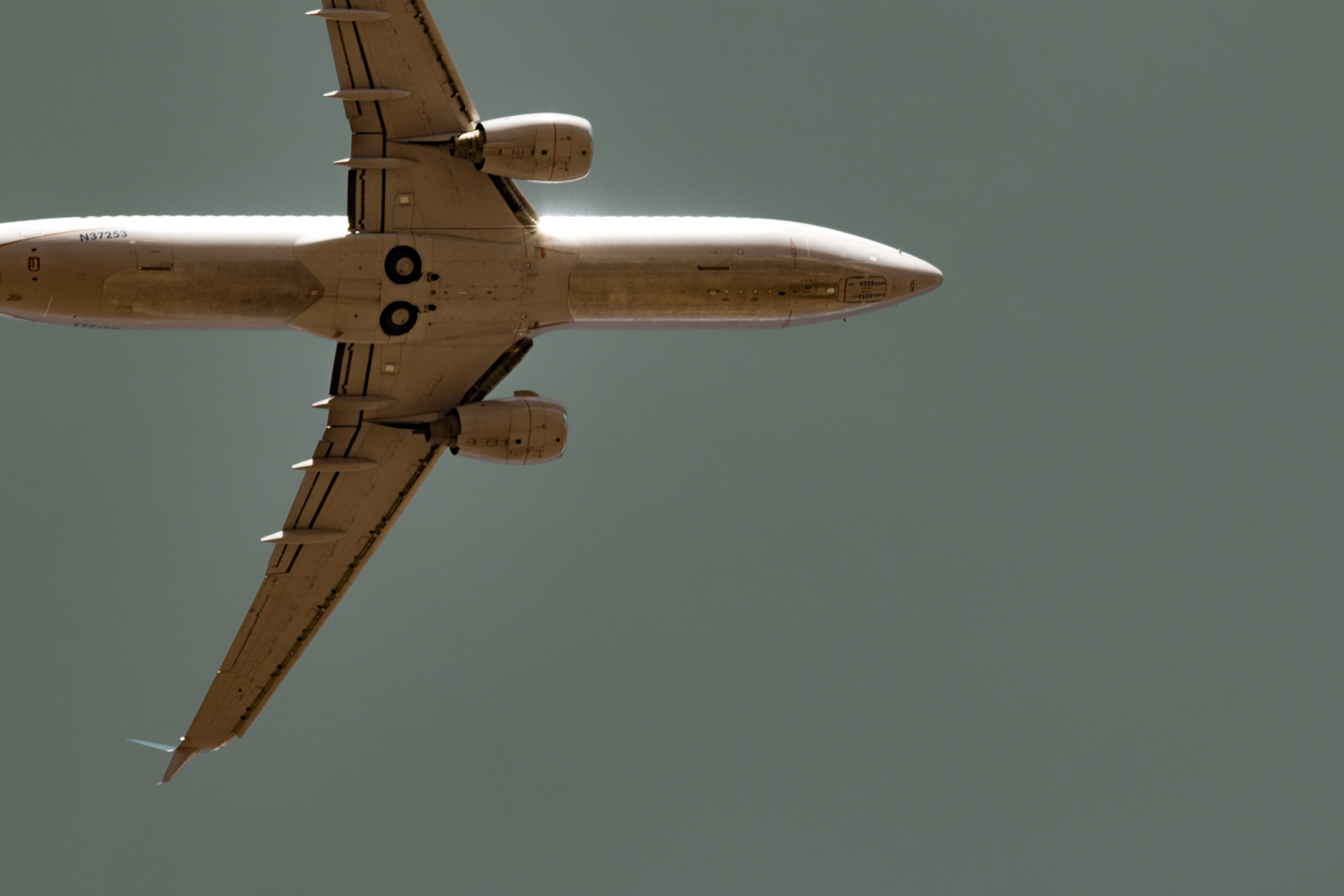 worm's-eye view of commercial airplane in sky