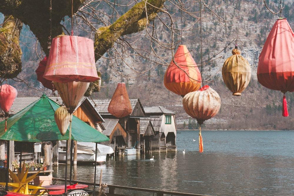 paper lanterns hanging on trees during daytime