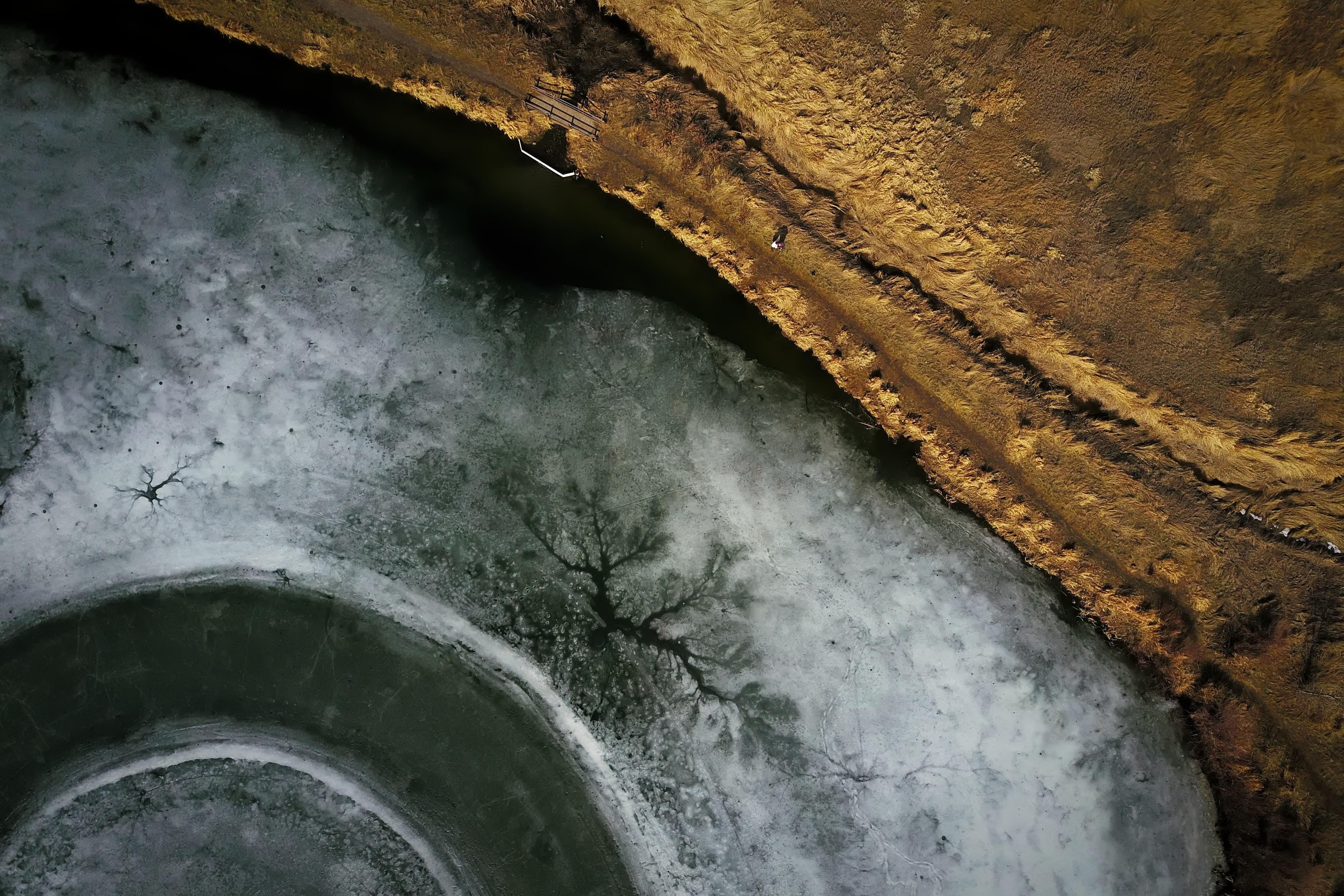 A drone shot of a frozen lake in Bozeman