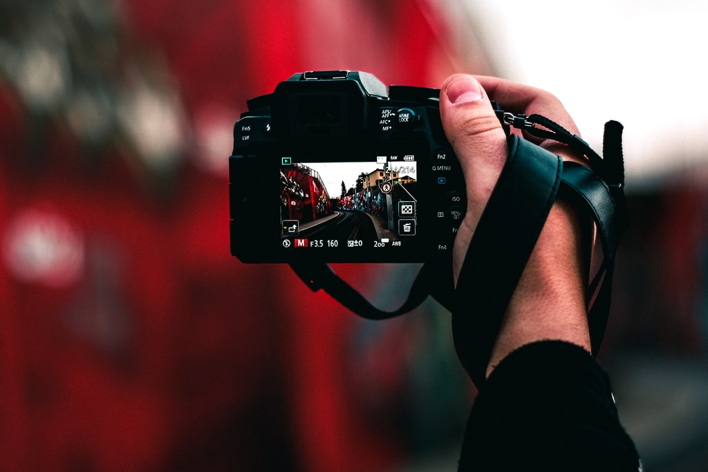 black DSLR camera capturing road