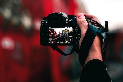 black dslr camera capturing road photographer zoom background