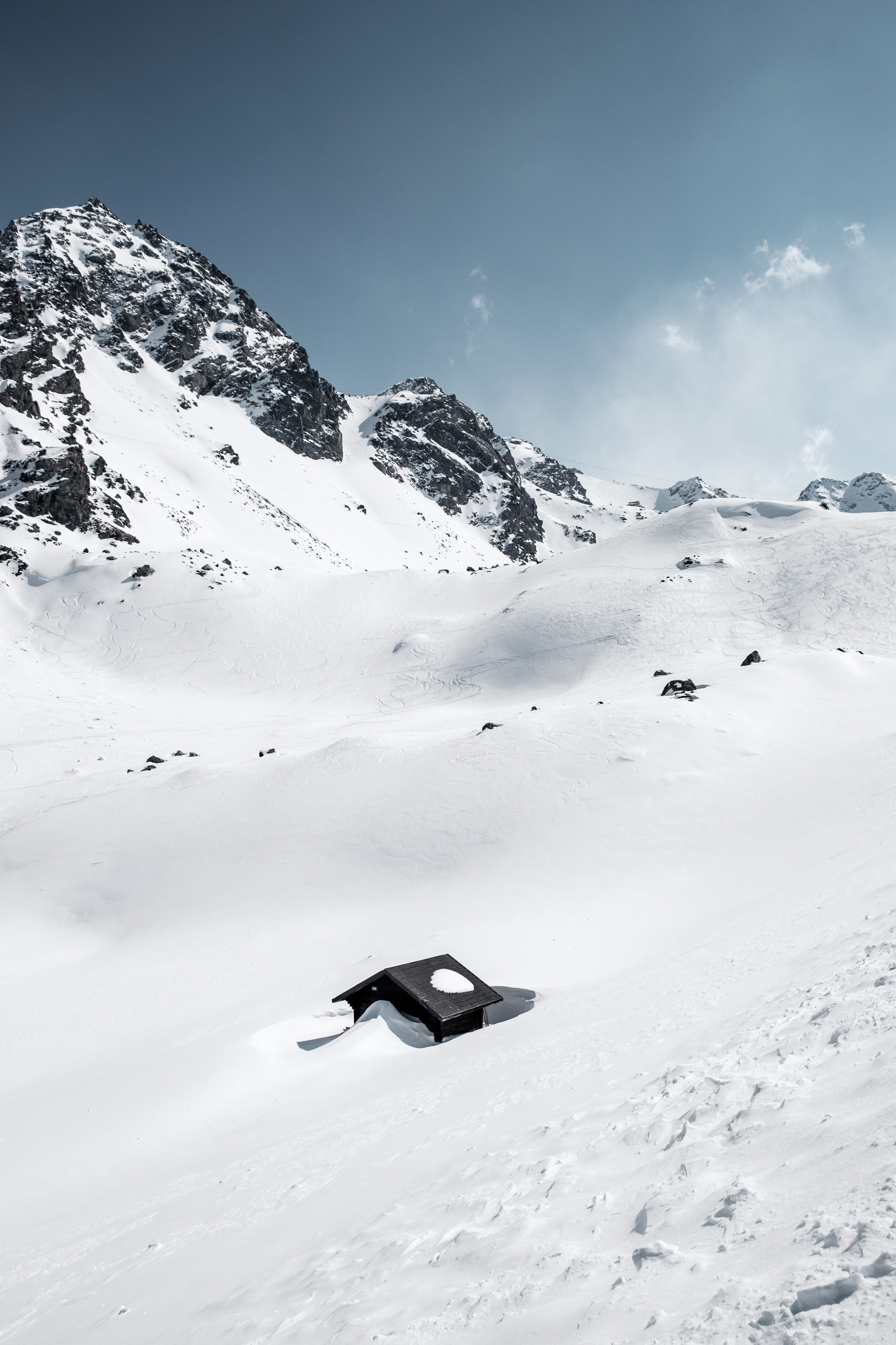 Snowy rocky mountains and hill ski trails in Verbier, Switzerland