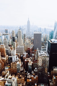 """""""This, like my last New York shot, was taken during my last trip to New York City. This was taken from the top of the Rockefeller Building looking towards the Empire State Building. If you look close you can see the Statue of Liberty in the upper back right."""""""
