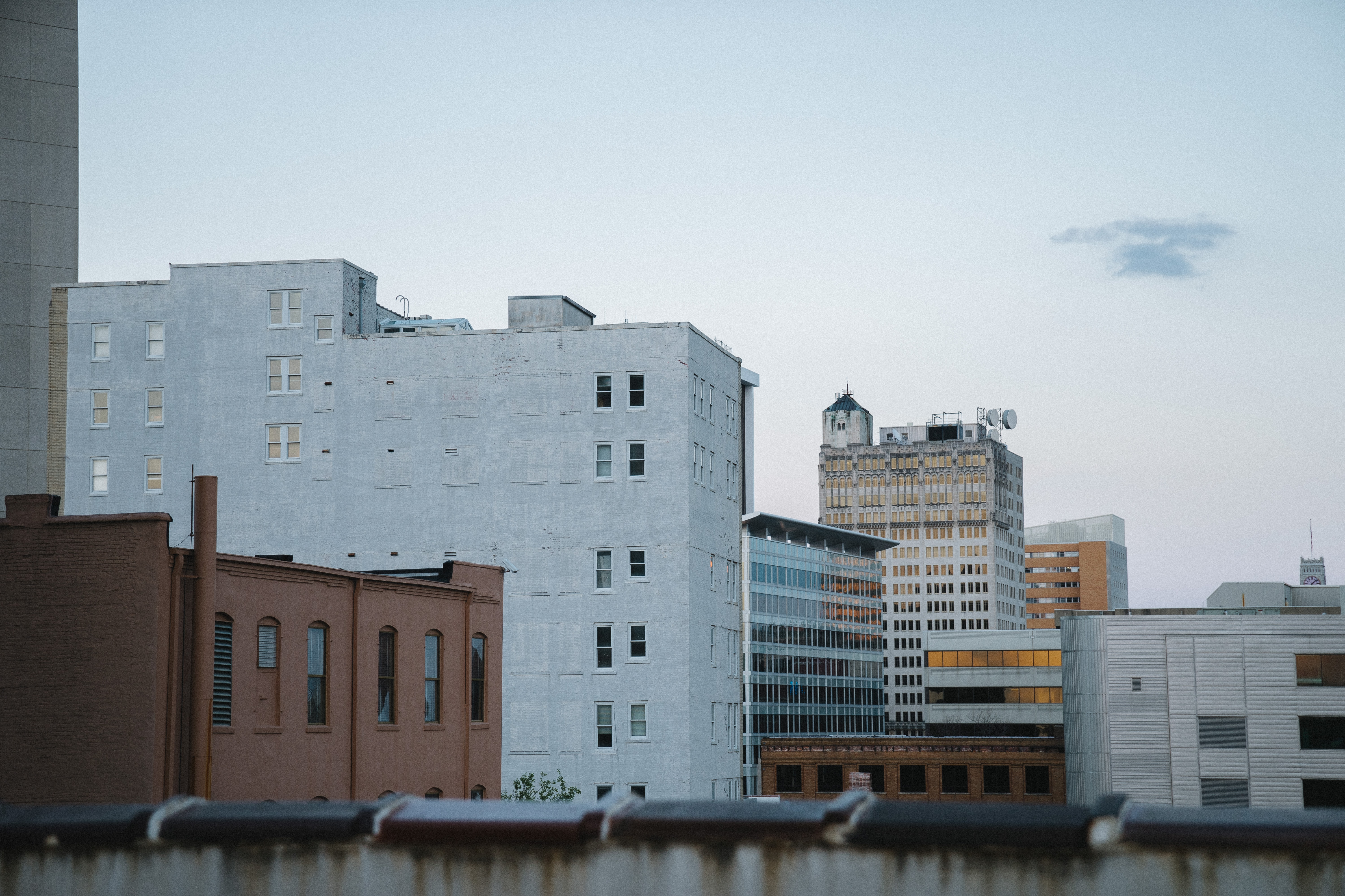 landscape photography of white and brown concrete buildings under cloudy sky