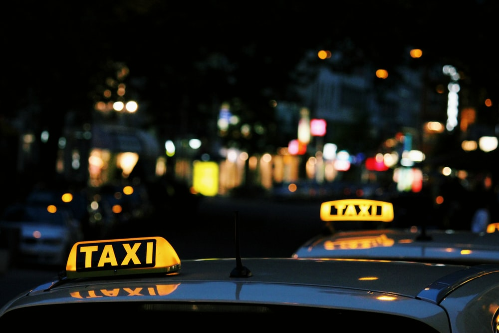 shallow focus photography of Taxi signage