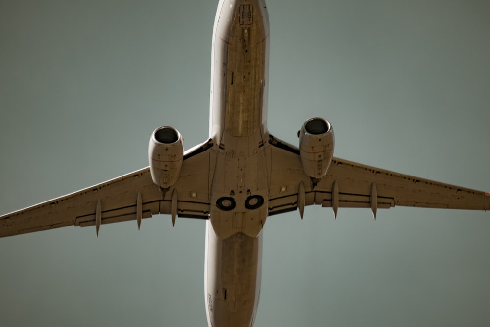 low angle photography of white airliner