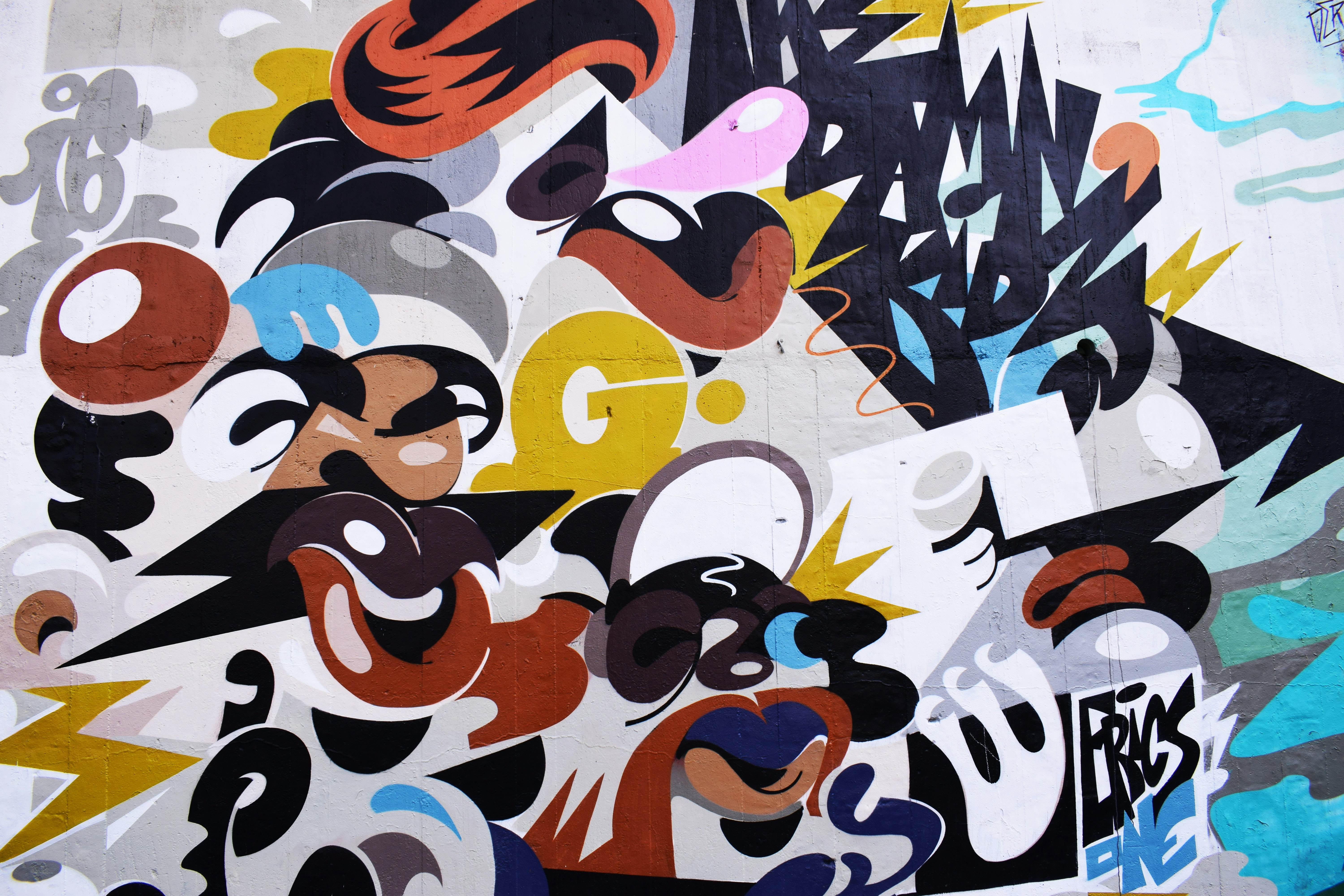 Colorful creative abstract street mural on wall