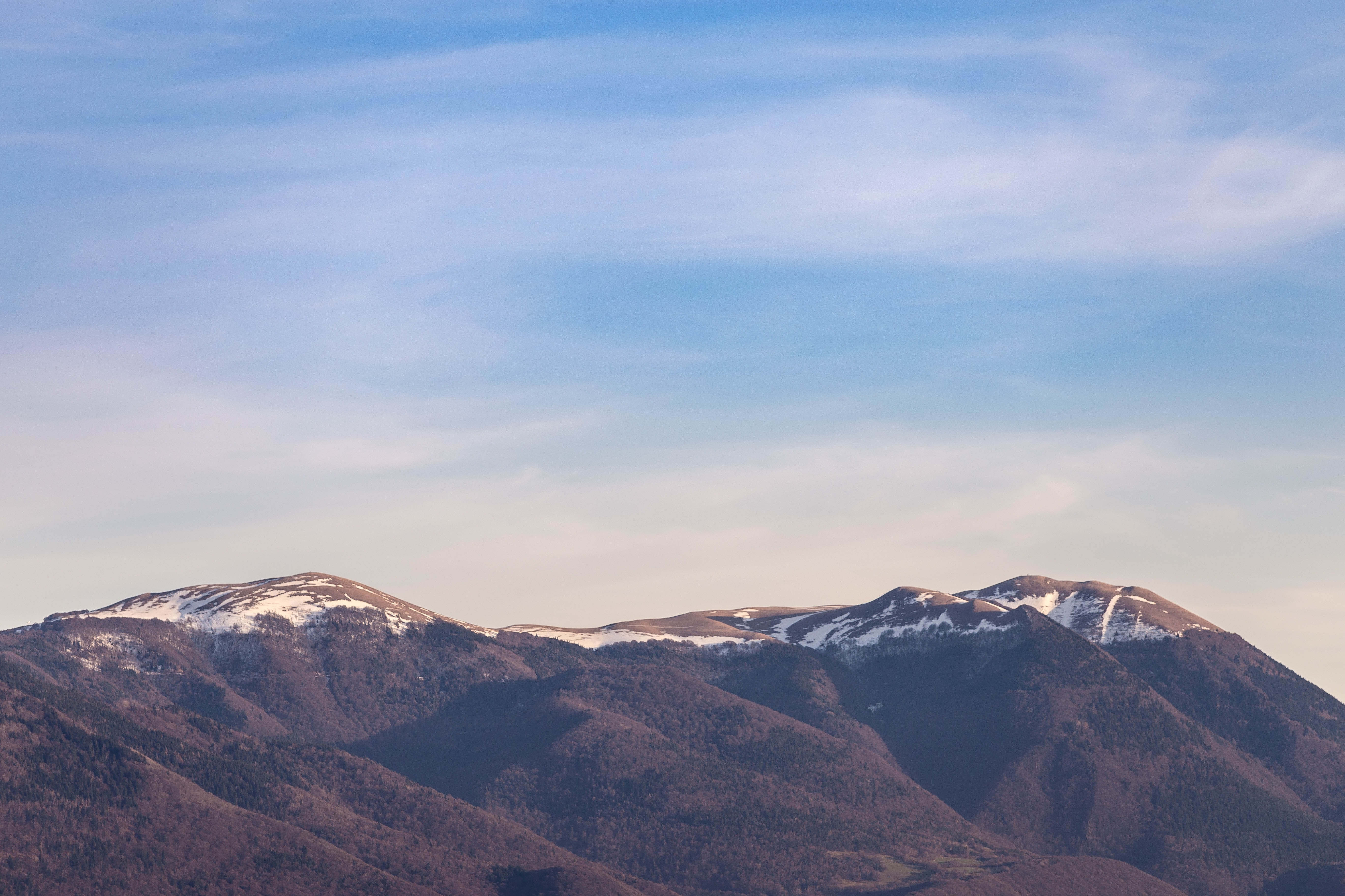 landscape photography of mountain range under clear blue sky