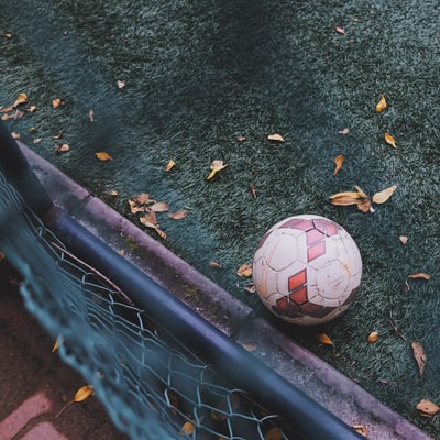 white and red soccer ball