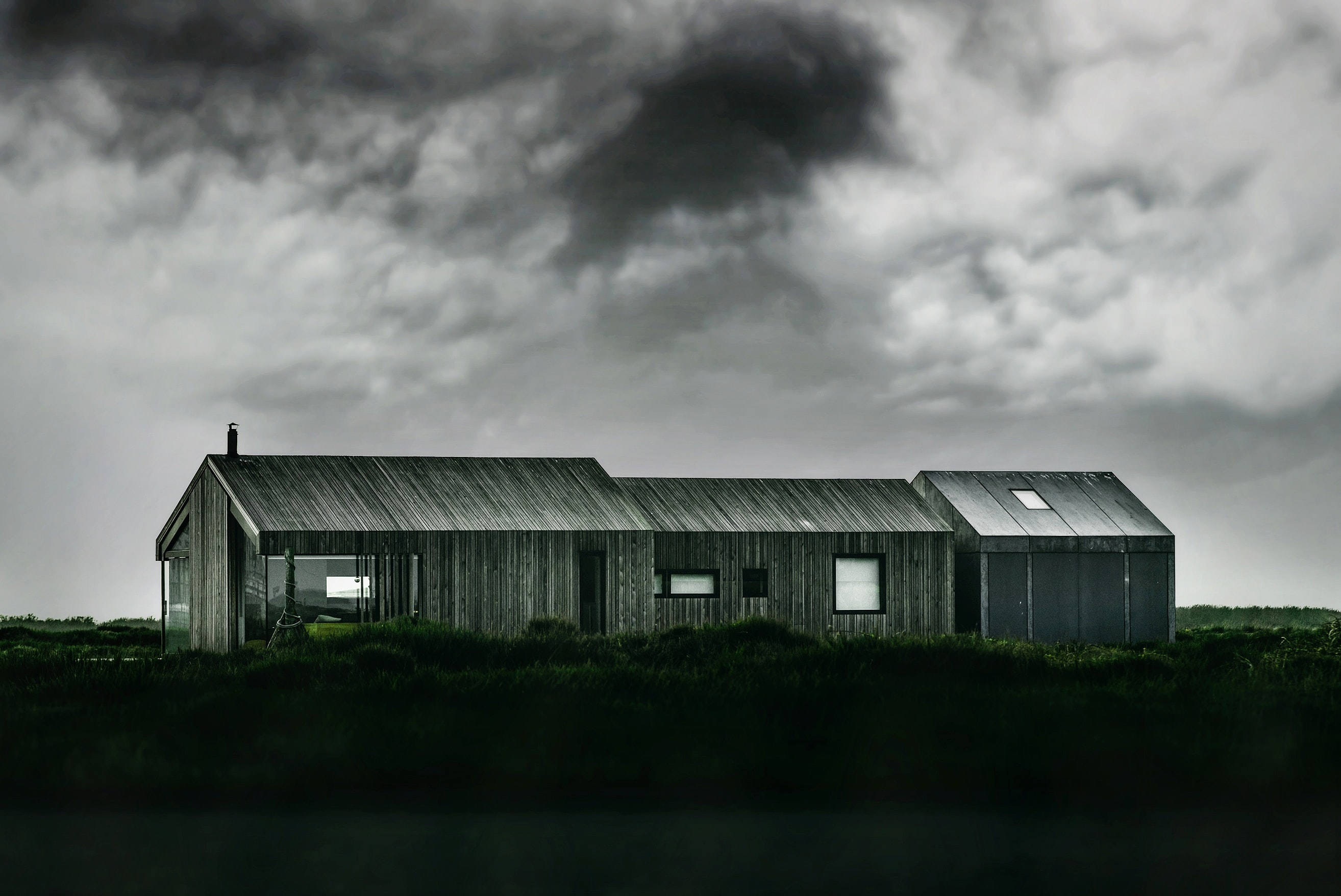 grayscale photo of wooden barn