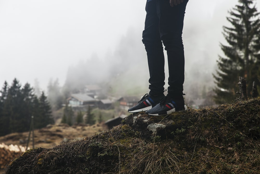 person standing on rock outdoor during daytime