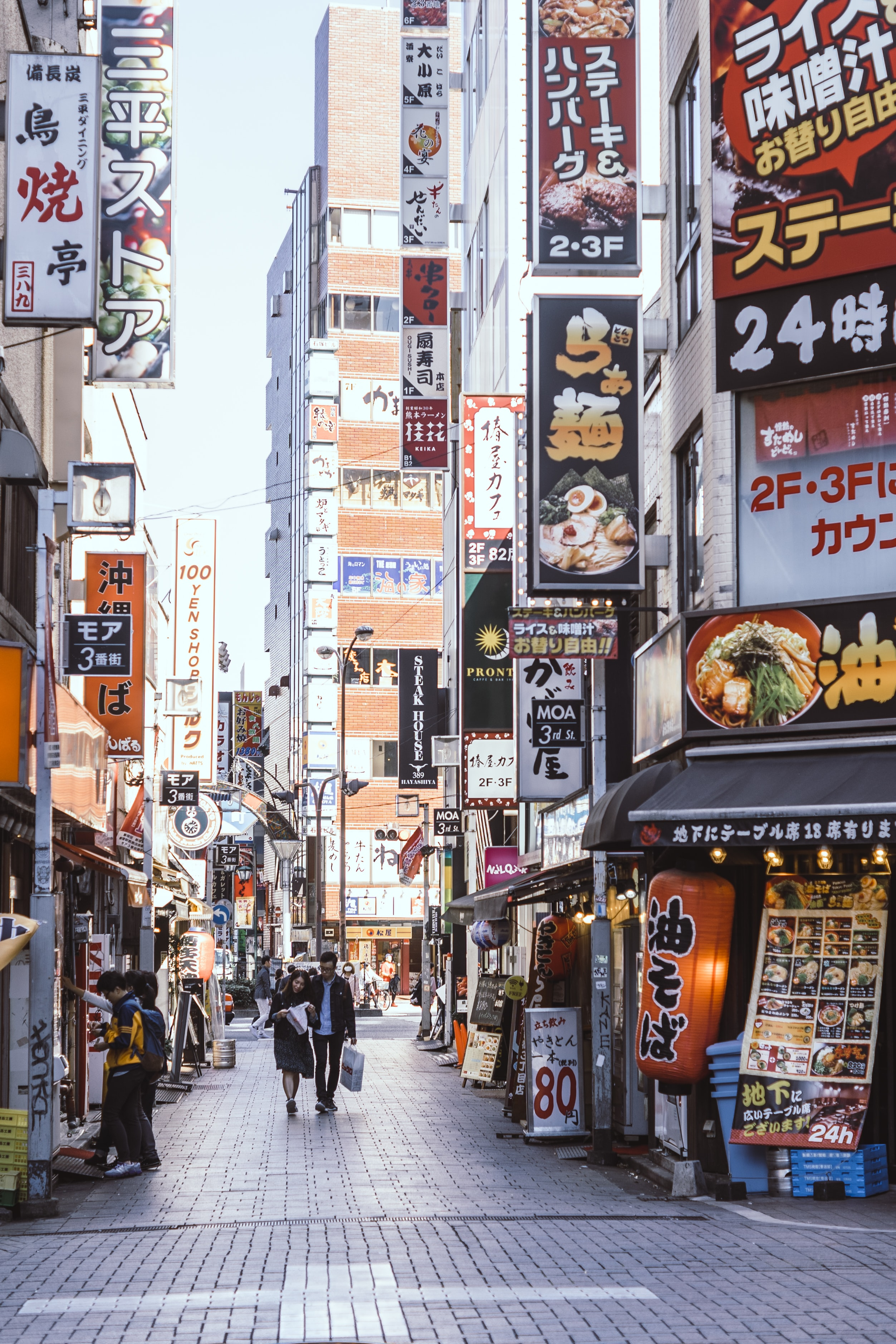 Shot of a Shinjuku street filled with restaurants and signs during the afternoon