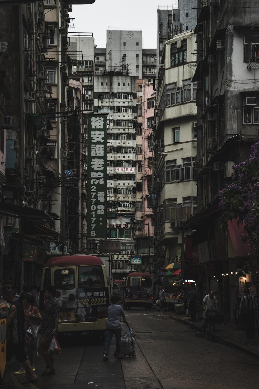 people walking in the street near high rise buildings