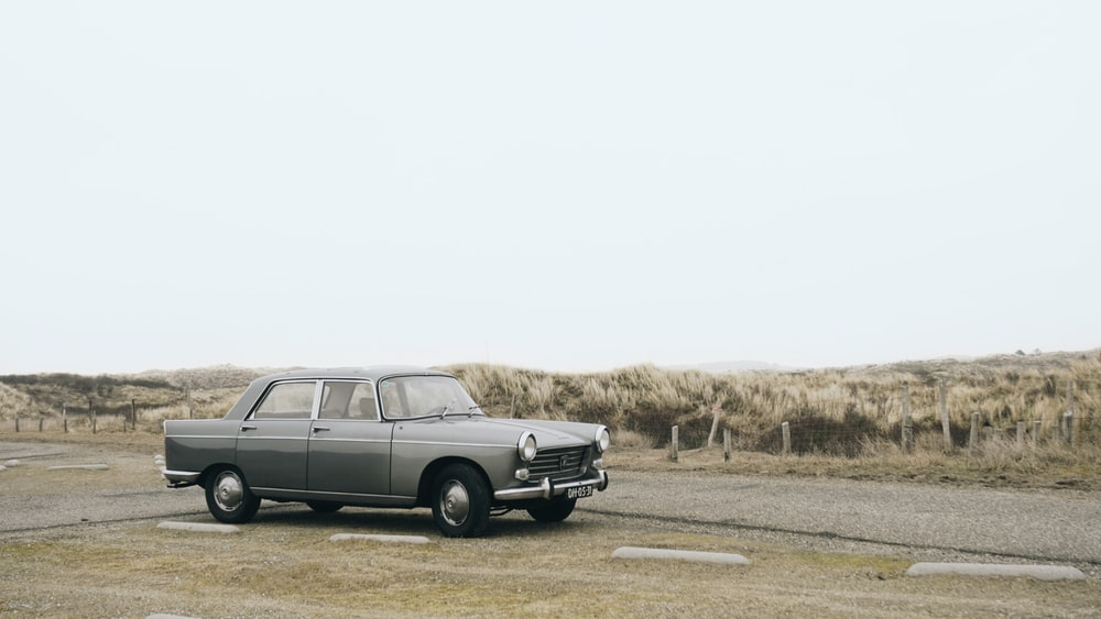 gray sedan parked on roadside during daytime