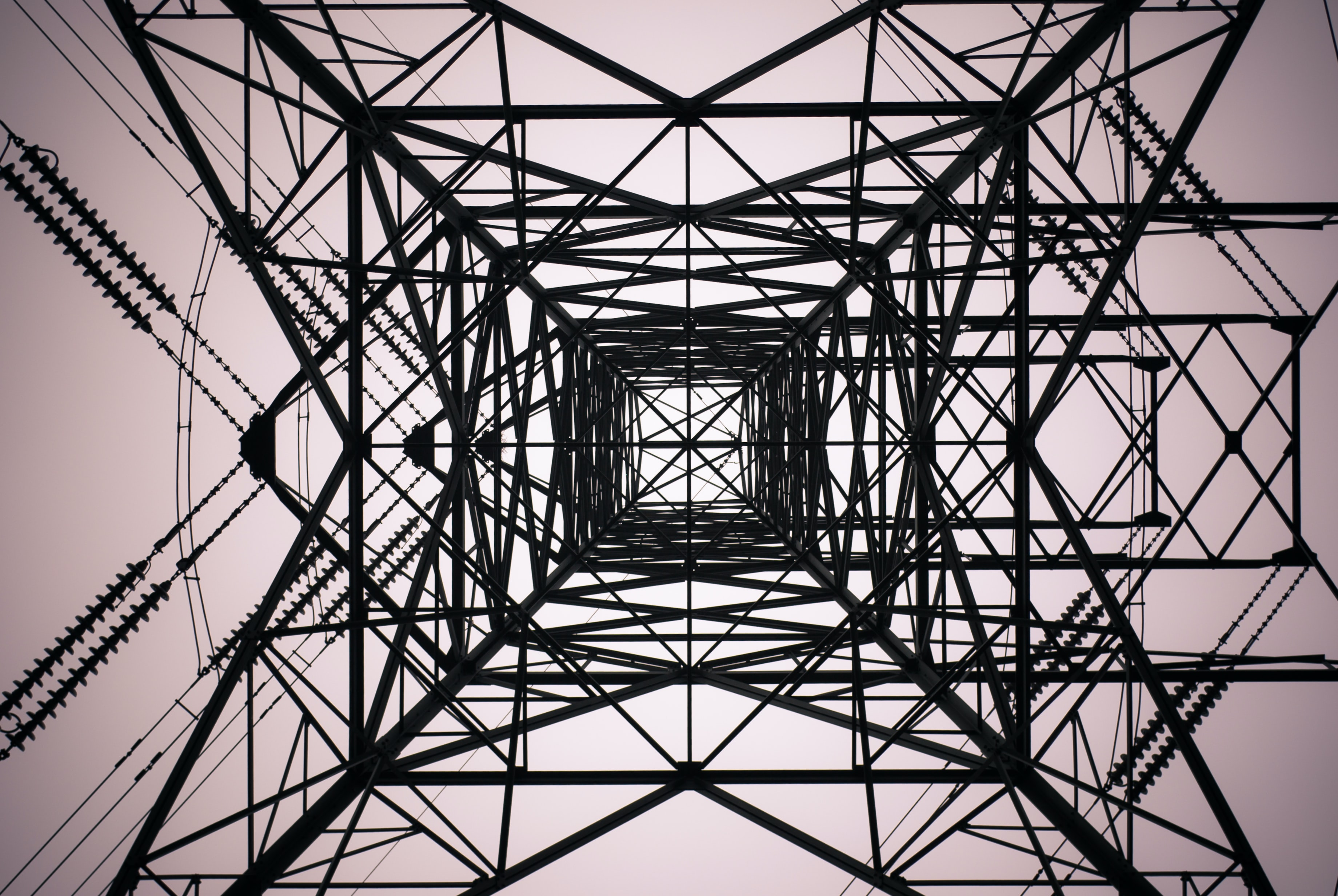 Skyward view from the base of a high voltage transmission tower in Sheffield.