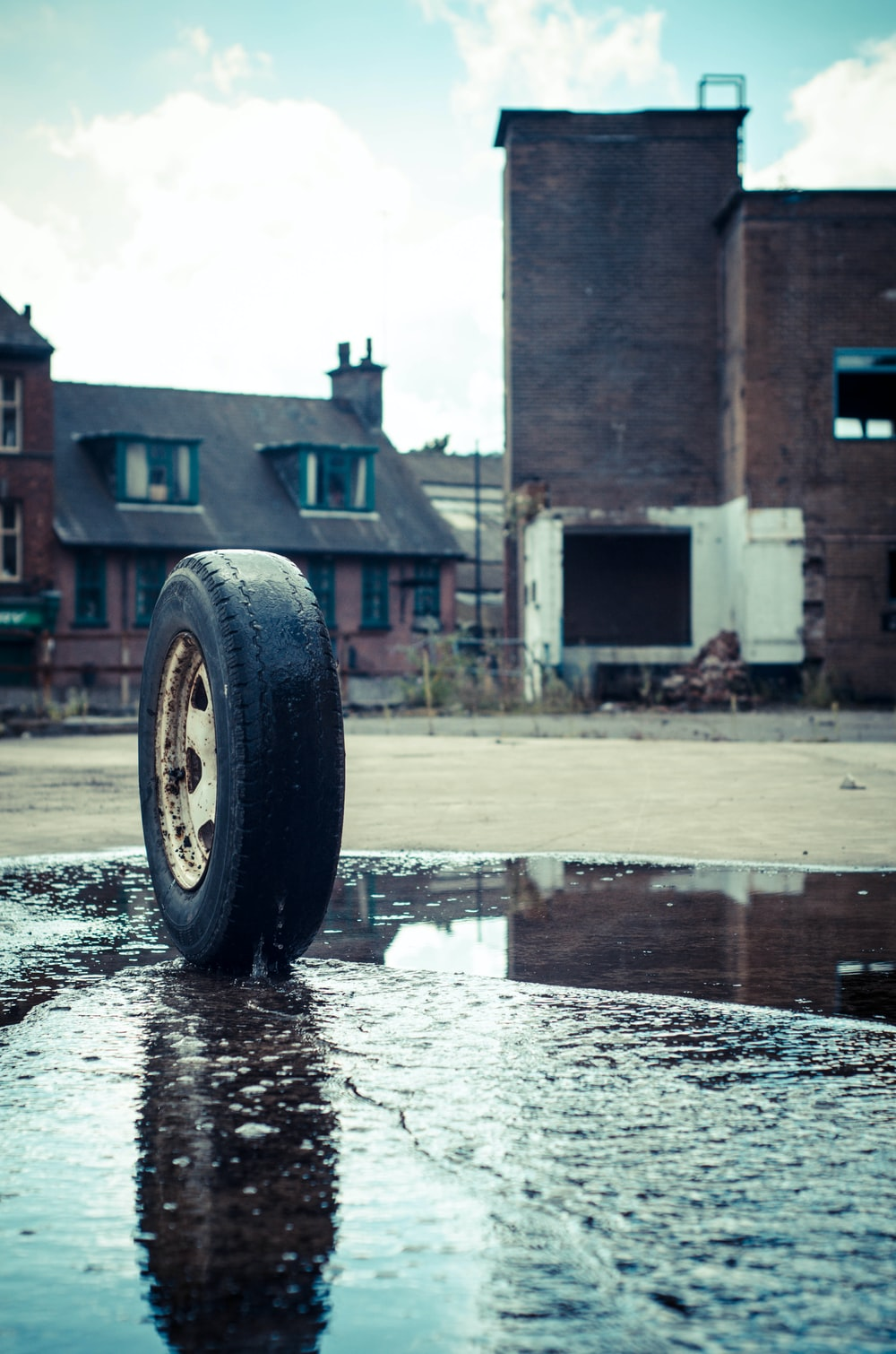vehicle tire on pavement with water
