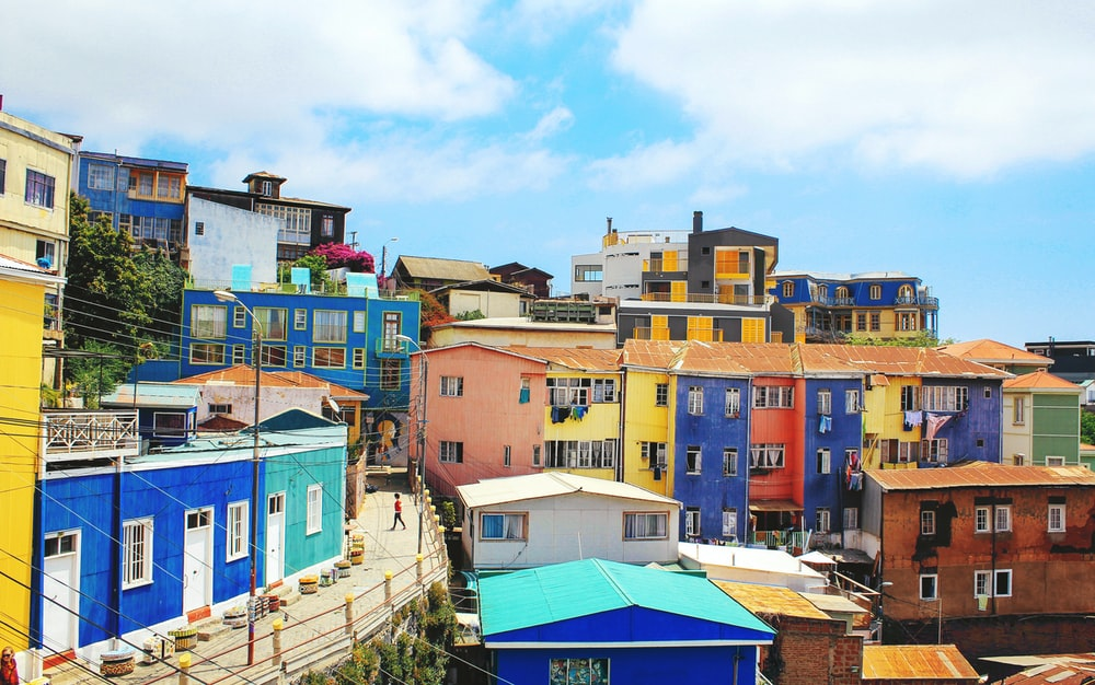 landscape photography of blue and yellow houses