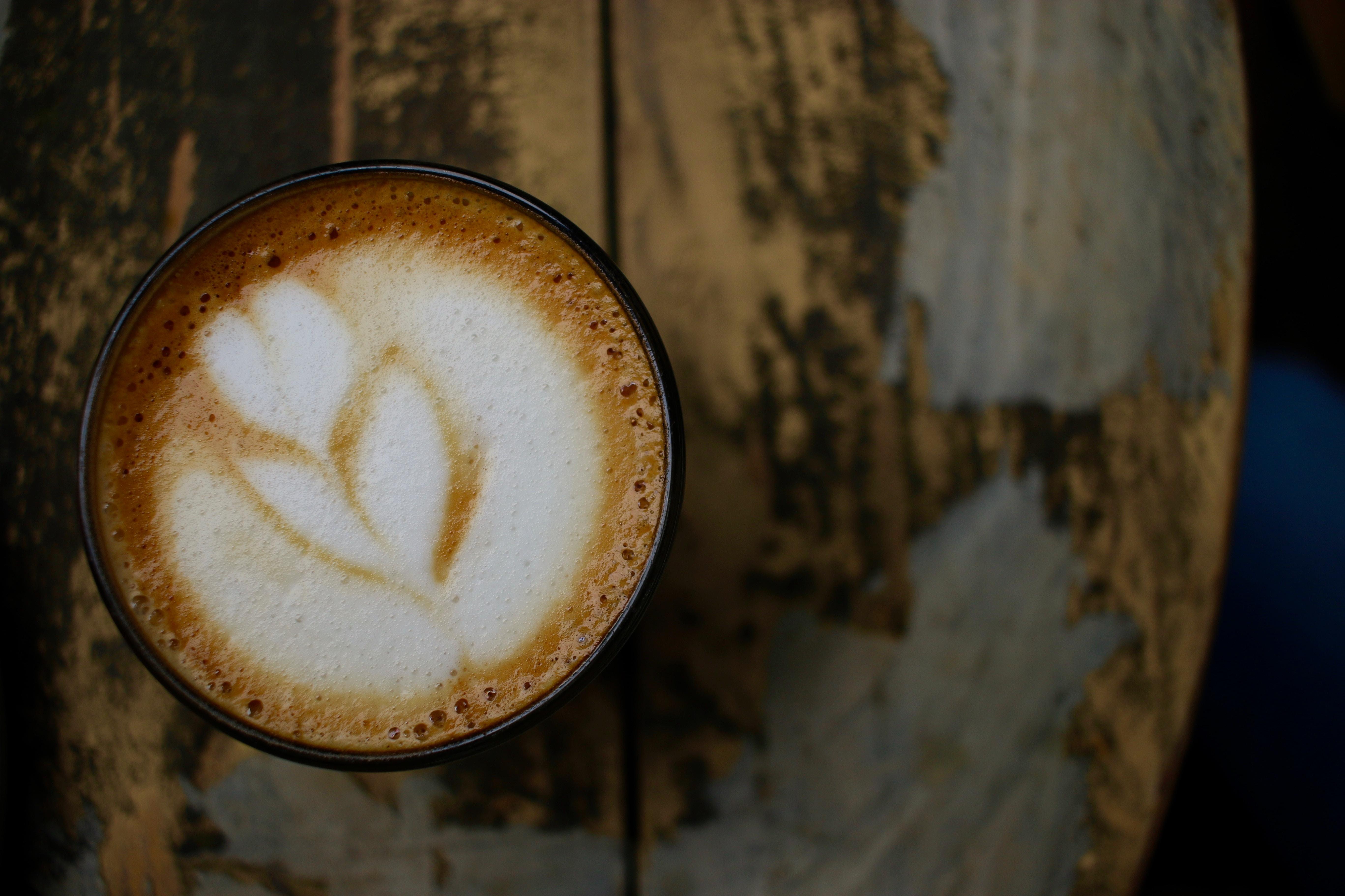 black mug filled with latte