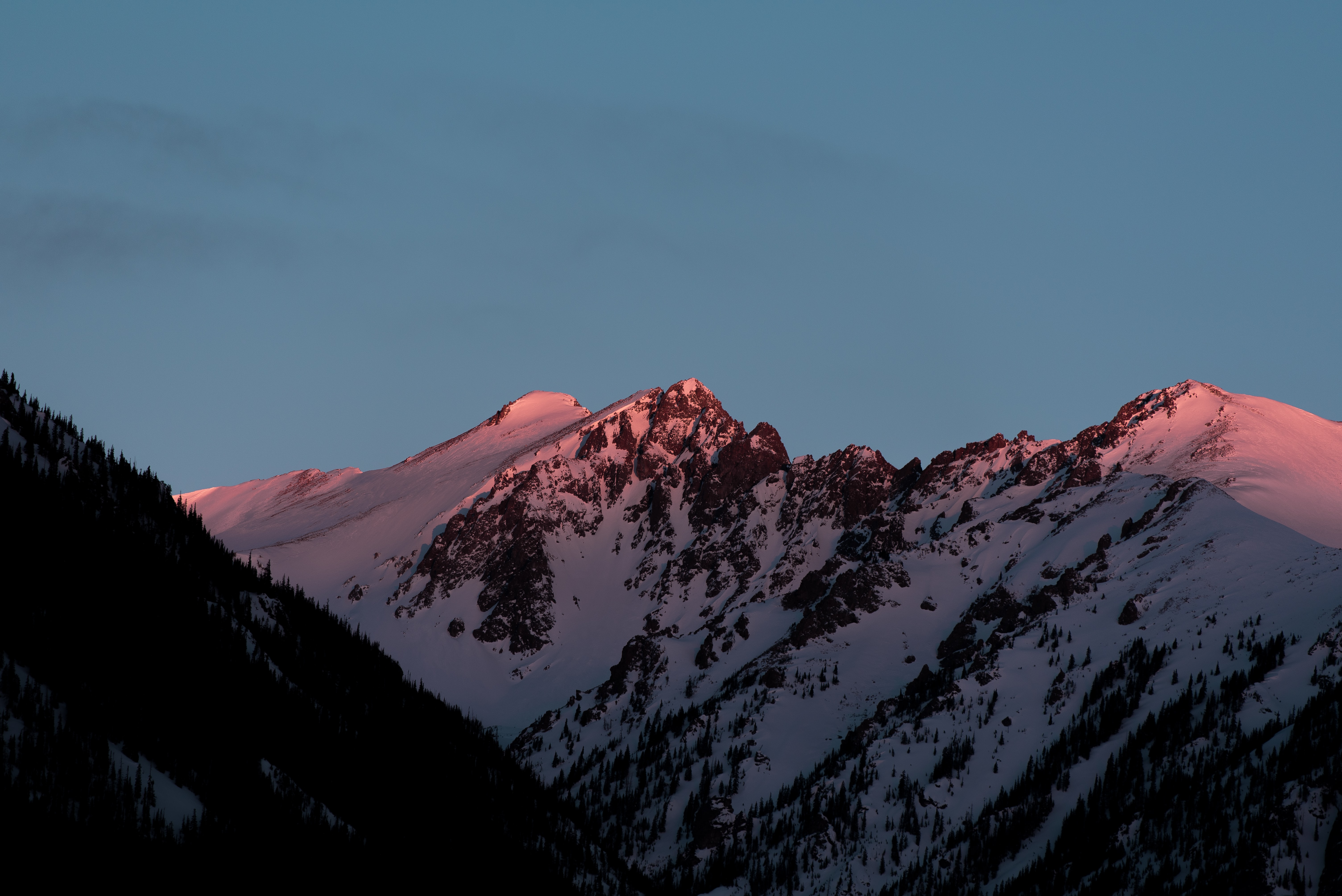 Shadow falling over a mountain ridge during sunset in Silverthorne
