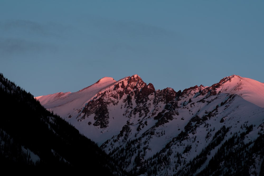 mountain covered in snow at golden hour