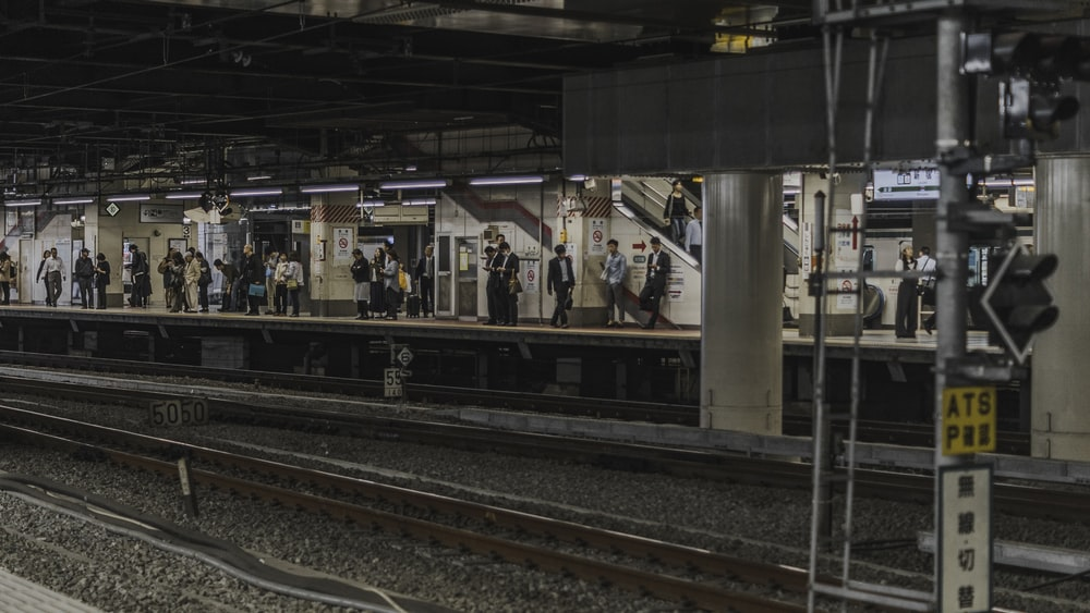 people waiting in train station