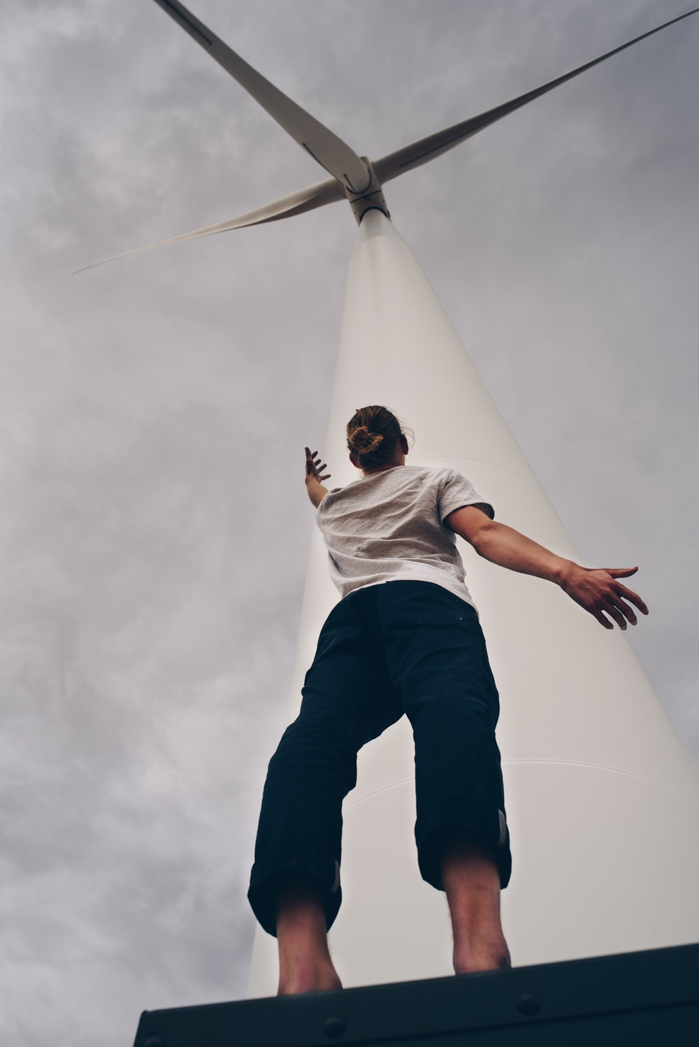 person standing on white wind mill