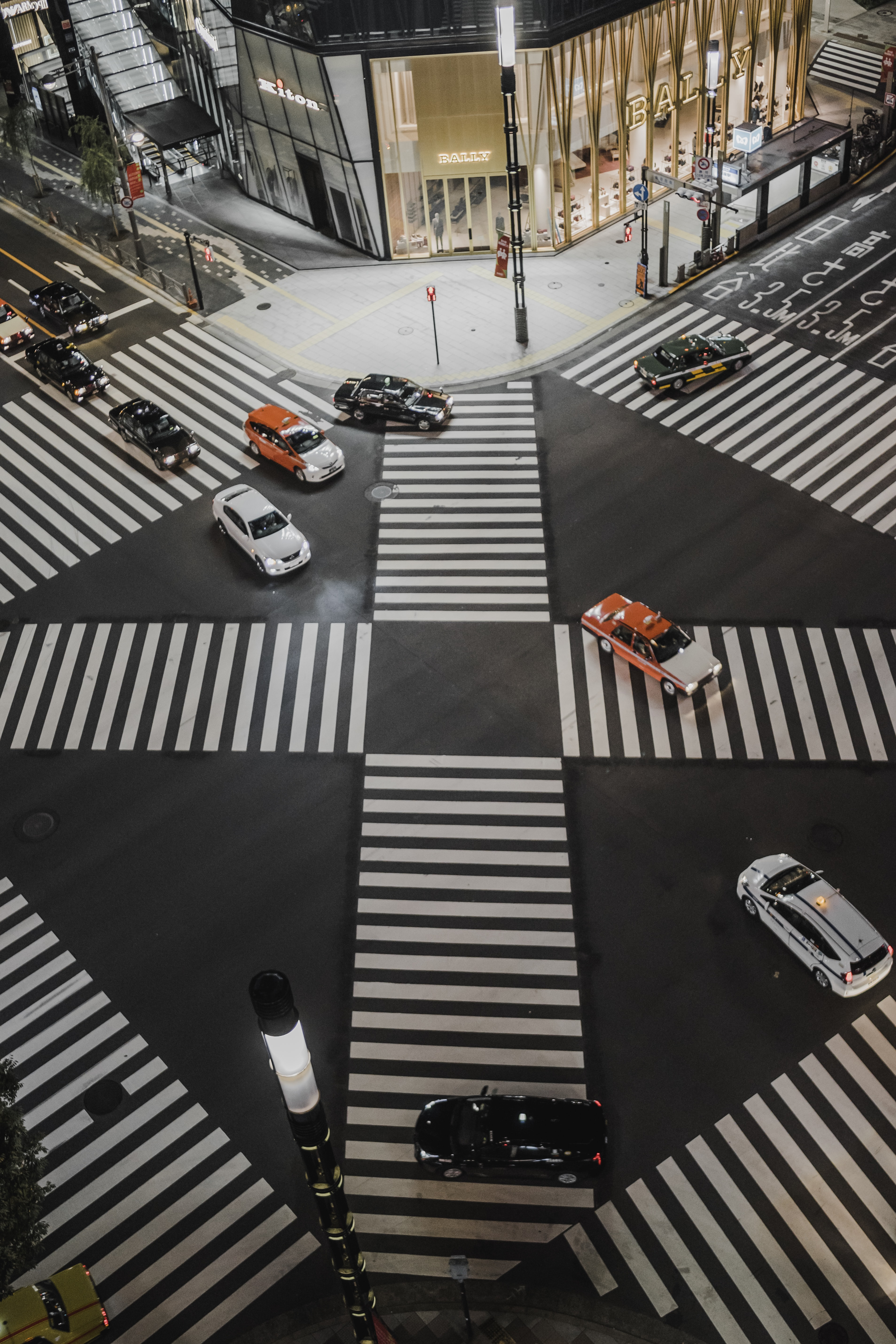 aerial view photo of vehicles crossing road