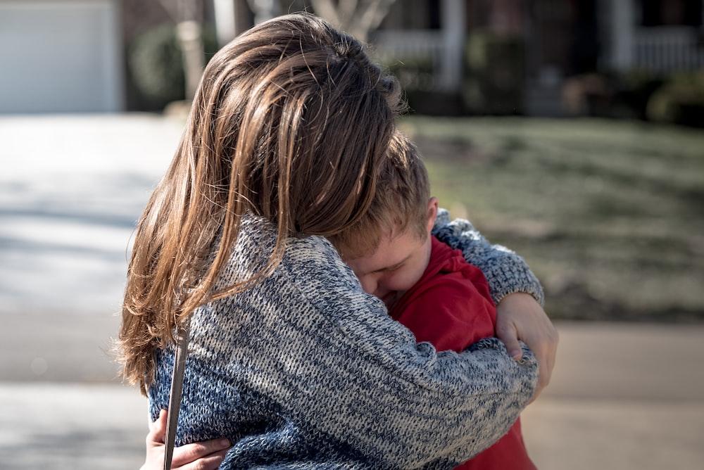 girl and boy hugging